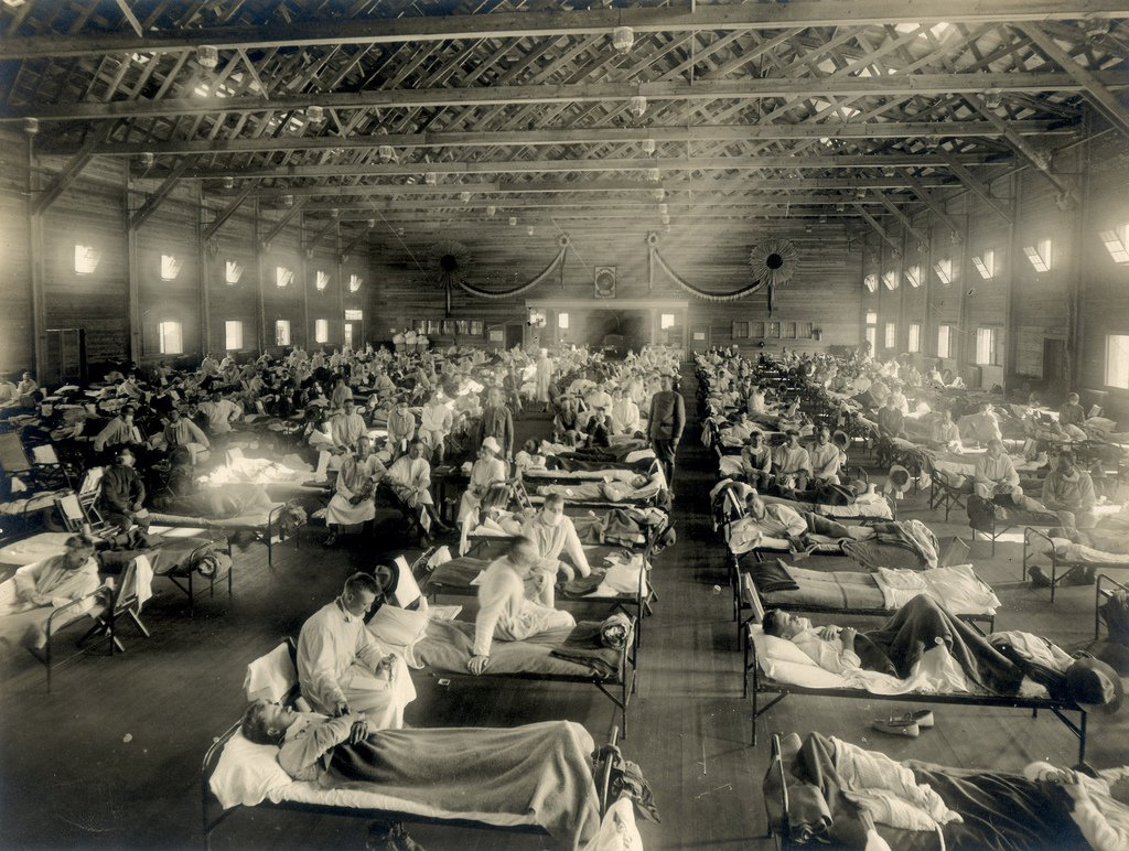 Soldiers from Fort Riley, Kansas, ill with Spanish flu at a hospital ward at Camp Funston. (Photo credit: Otis Historical Archives, National Museum of Health and Medicine )