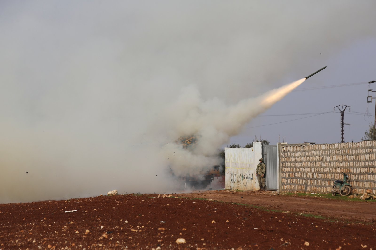 Turkish soldiers fire a missile at Assad regime position in the province of Idlib, Syria, Friday, Feb. 14, 2020. (AP Photo)