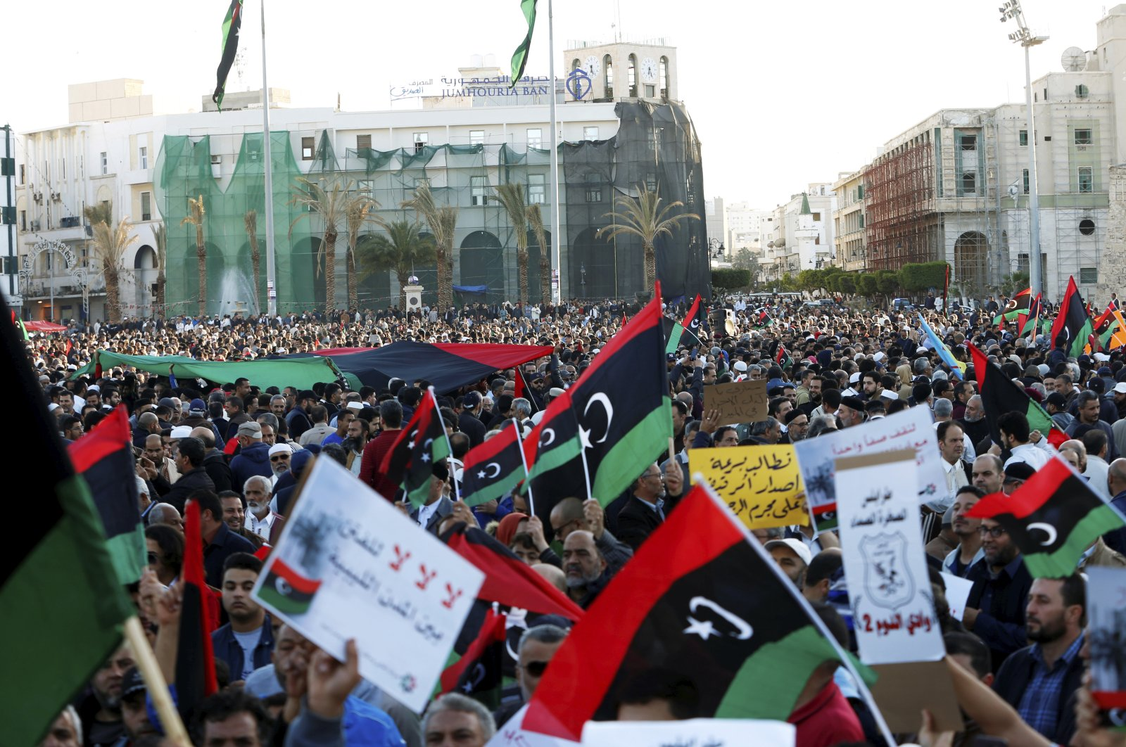 Libyan protesters attend a demonstration to demand an end to putschist Gen. Khalifa Haftar's offensive against Tripoli, in Martyrs Square in central Tripoli, Apr. 12, 2019. (REUTERS Photo)
