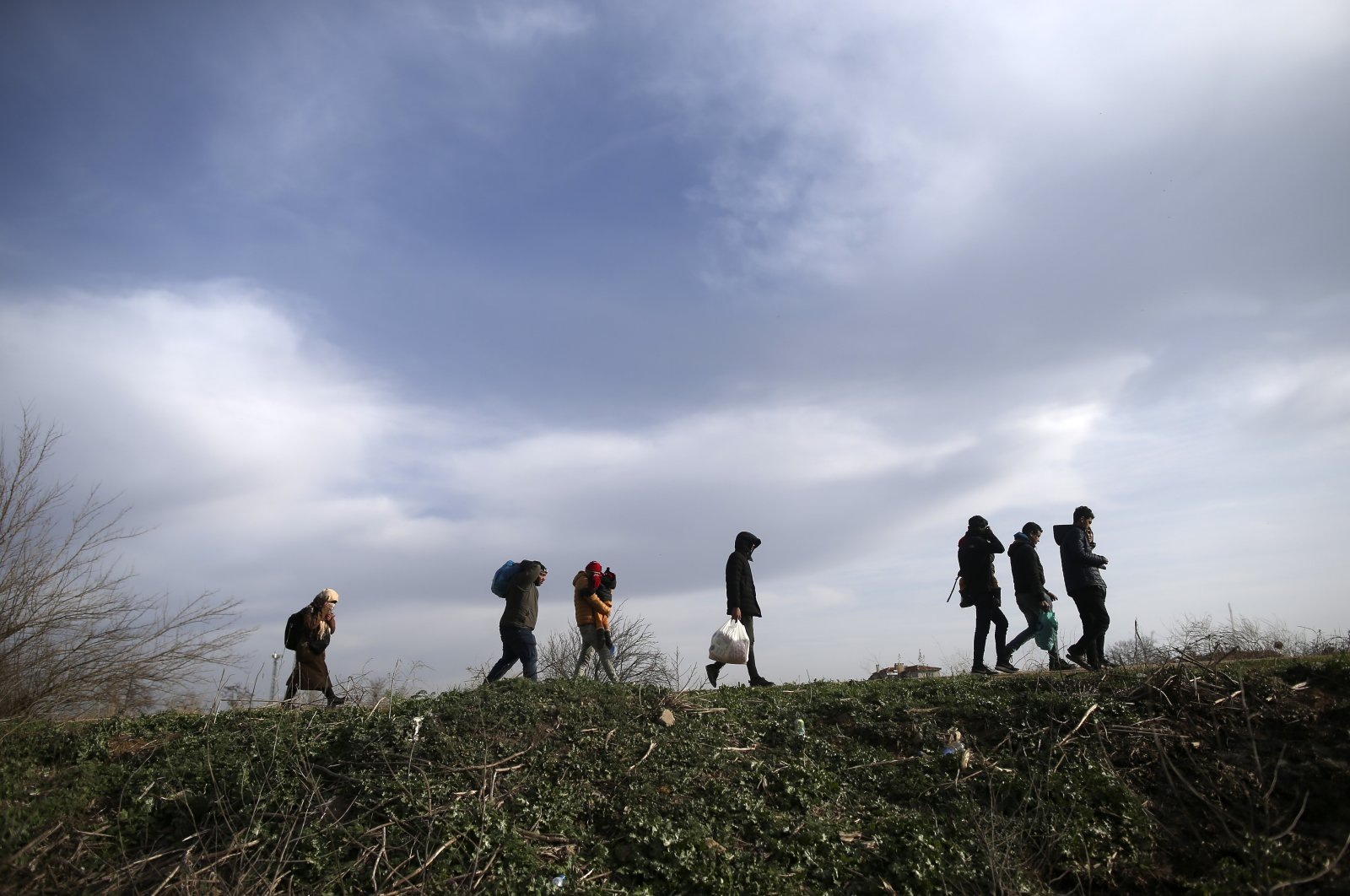 Migrants walk in Edirne at the Turkish-Greek border, March 9, 2020. (AP Photo)