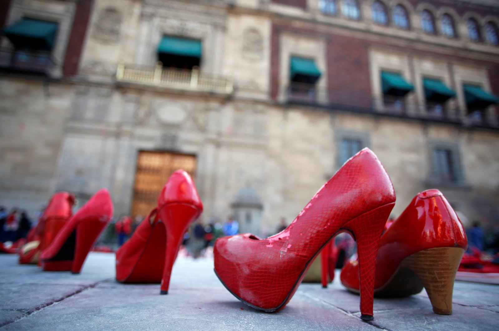 """Pairs of women's red shoes are displayed during """"A Day Without Women"""" protest, as part of the escalation of historic protests against gender violence, outside the National Palace in Mexico City, Mexico, March 9, 2020. (Reuters Photo)"""