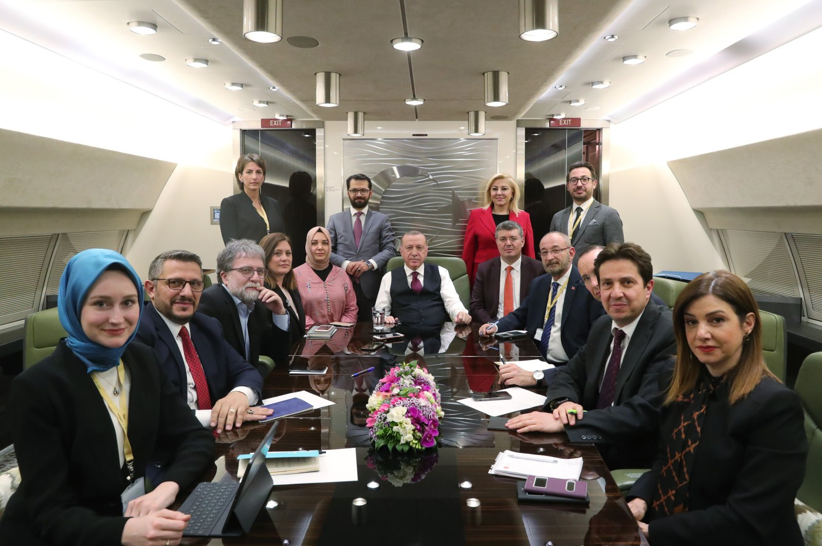 President Recep Tayyip Erdoğan (C) with journalists, including Daily Sabah's Ankara Chief Nur Özkan Erbayon, on the presidential plane on his way back from Brussels, March 9, 2020.