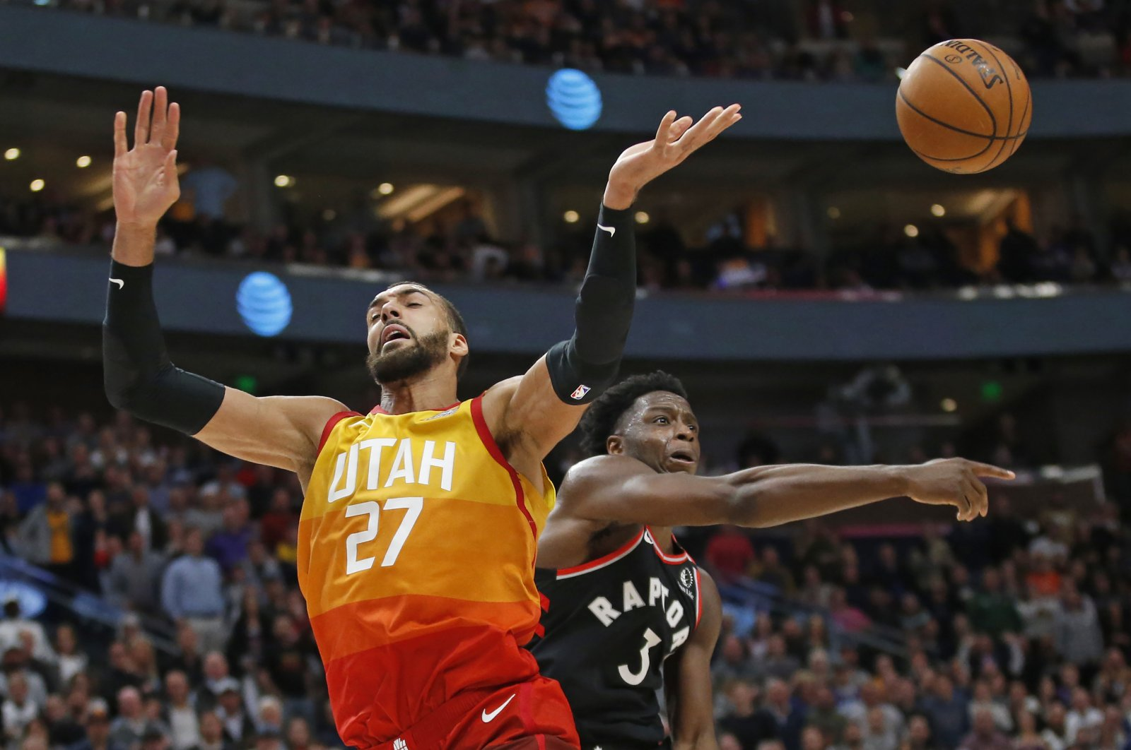 Toronto Raptors forward OG Anunoby (3) knocks the ball from Utah Jazz center Rudy Gobert (27) as he drives to the basket in the second half during an NBA basketball game, Salt Lake City, March 9, 2020. (AP Photo)