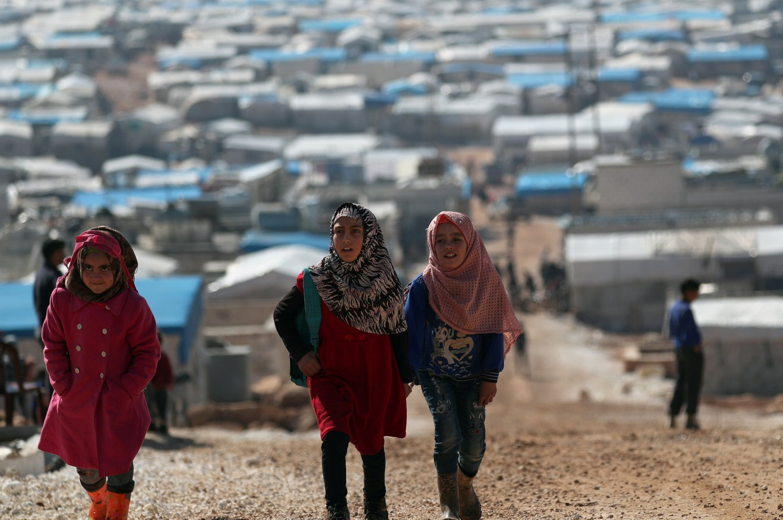 Internally displaced Syrian students walk together in Atmeh IDP camp, located near the border with Turkey, Syria, Mar. 4, 2020. (REUTERS Photo)