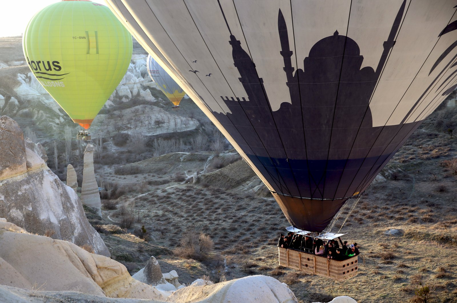 People are seen aboard a hot air balloon in Cappadocia, one of Turkey's top destinations, March 10, 2020. (AA Photo)