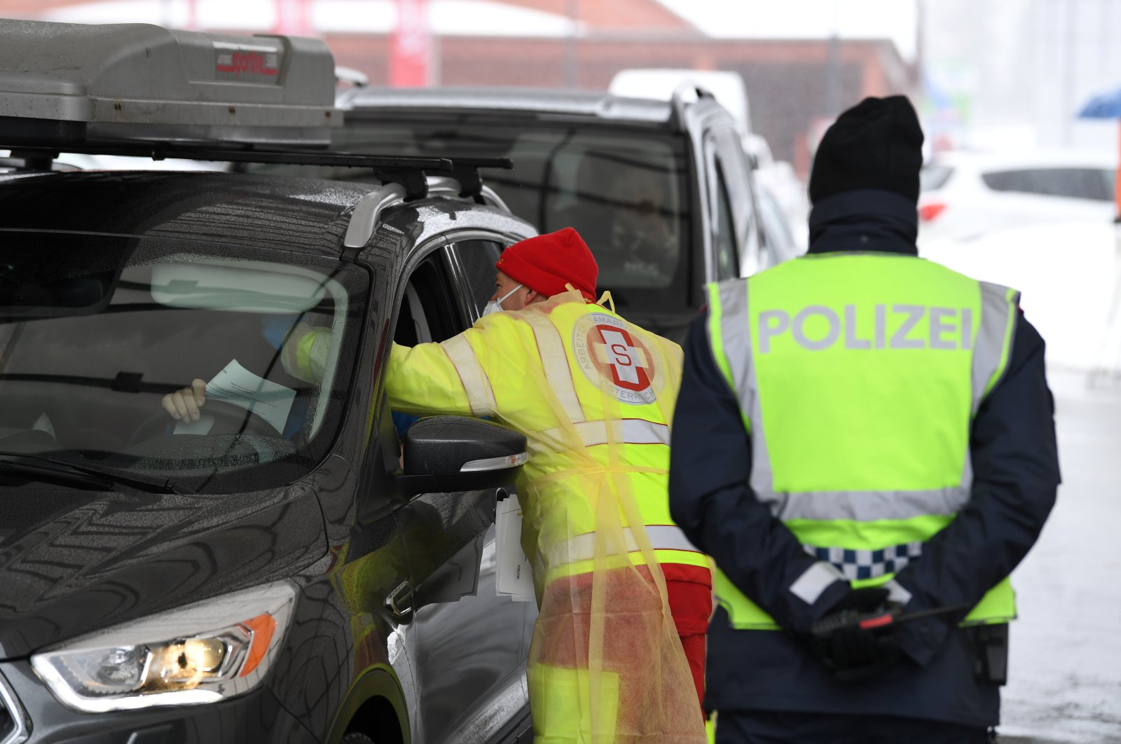 A medic checks the temperature of a driver coming from Italy due to the spread of the coronavirus disease (COVID-19) in Italy at the Brenner Pass border crossing between Italy and Austria, March 10, 2020. (Reuters Photo)