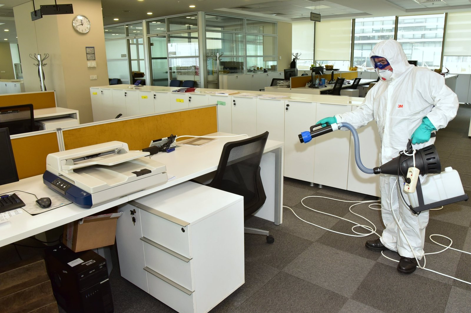 A man seen with a disinfection equippment in an office in Turkey. (IHA Photo)