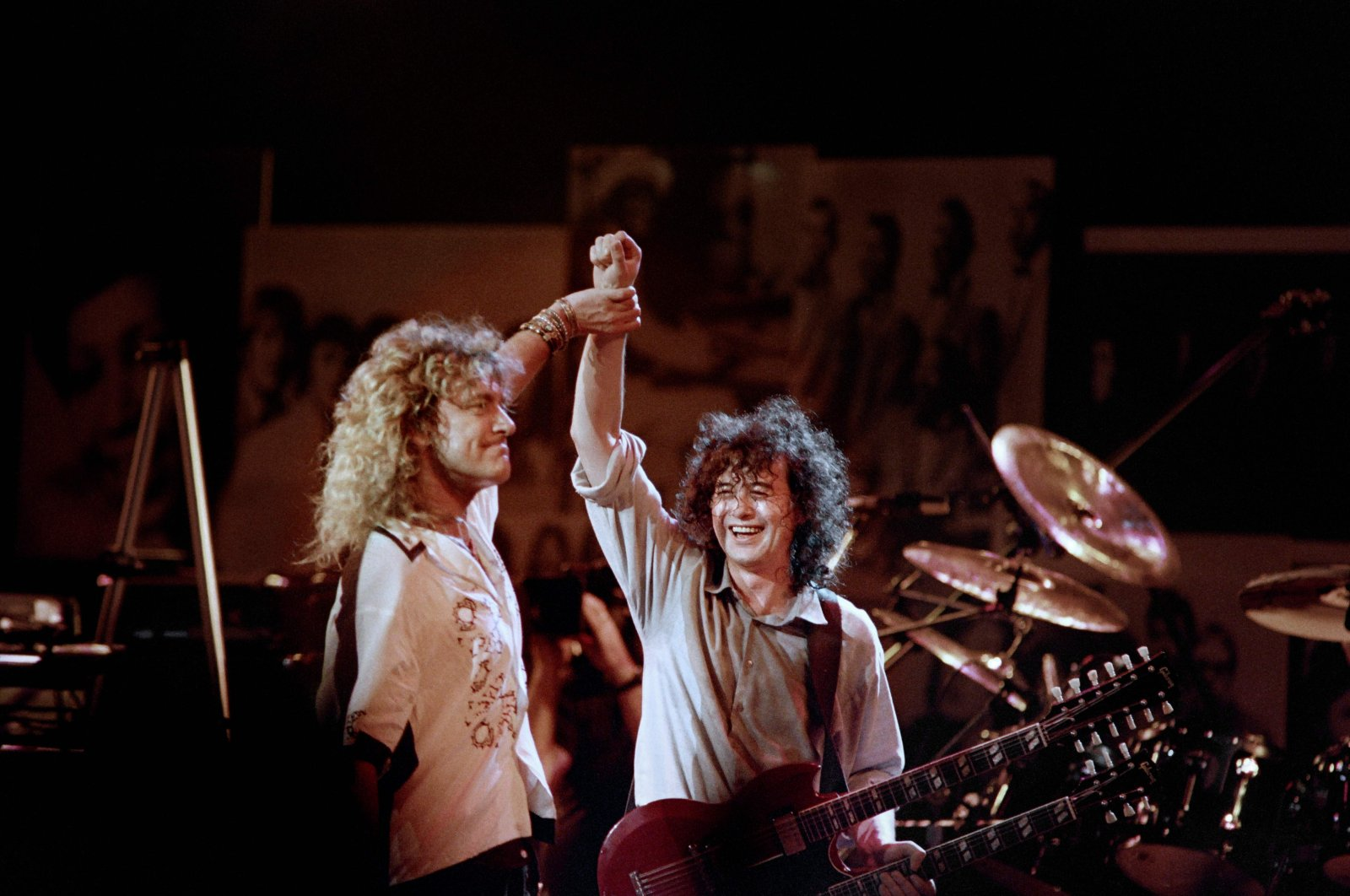 In this file photo, British singer Robert Plant (L) holds hands raised high with British guitarist Jimmy Page during a Led Zeppelin reunion performance at Madison Square Garden in New York, May 14, 1988. (AFP Photo)