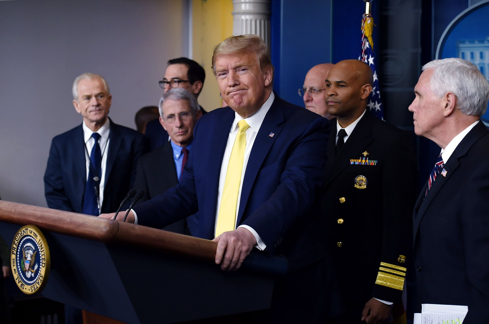 U.S. President Donald Trump speaks about the COVID-19 (coronavirus) alongside Vice President Mike Pence and members of the Coronavirus Task Force at the White House in Washington, D.C., March 9, 2020. (AFP Photo)