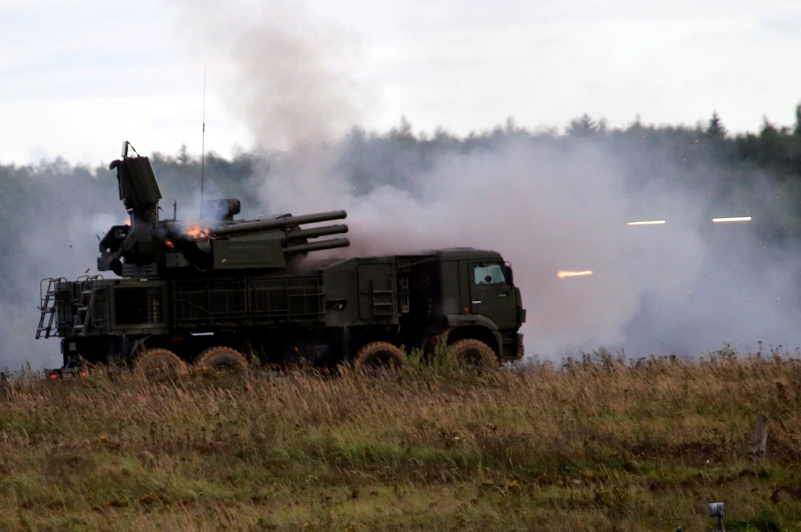 "A Russian Pantsir-S1 missile and artillery weapon system fires during a demonstration at the international military-technical forum ""ARMY-2016"" in Moscow region, Russia, September 6, 2016. (Reuters Photo)"