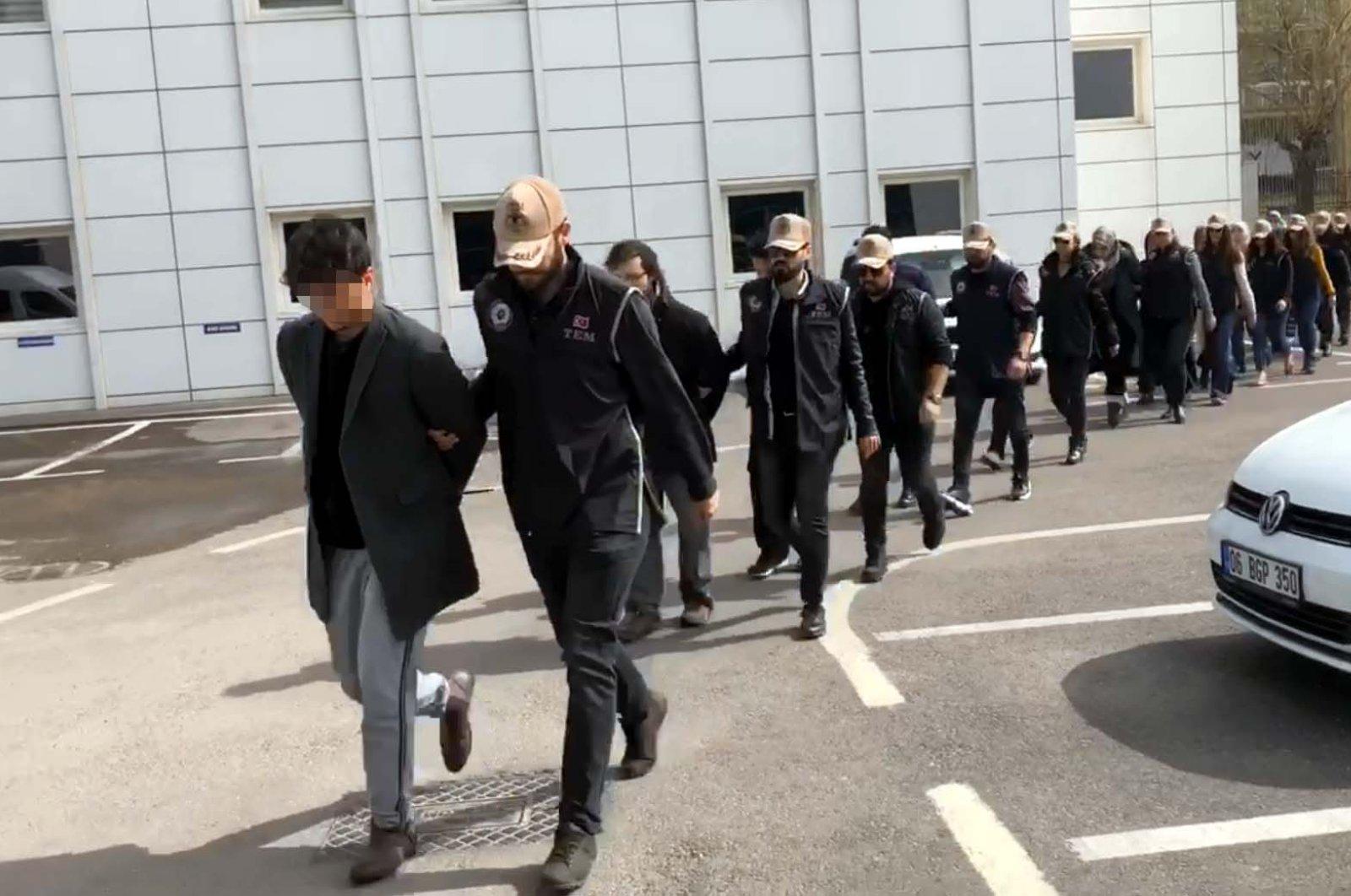 Police escort FETÖ suspects captured in an operation, Ankara, Mar. 9, 2020. (DHA Photo)