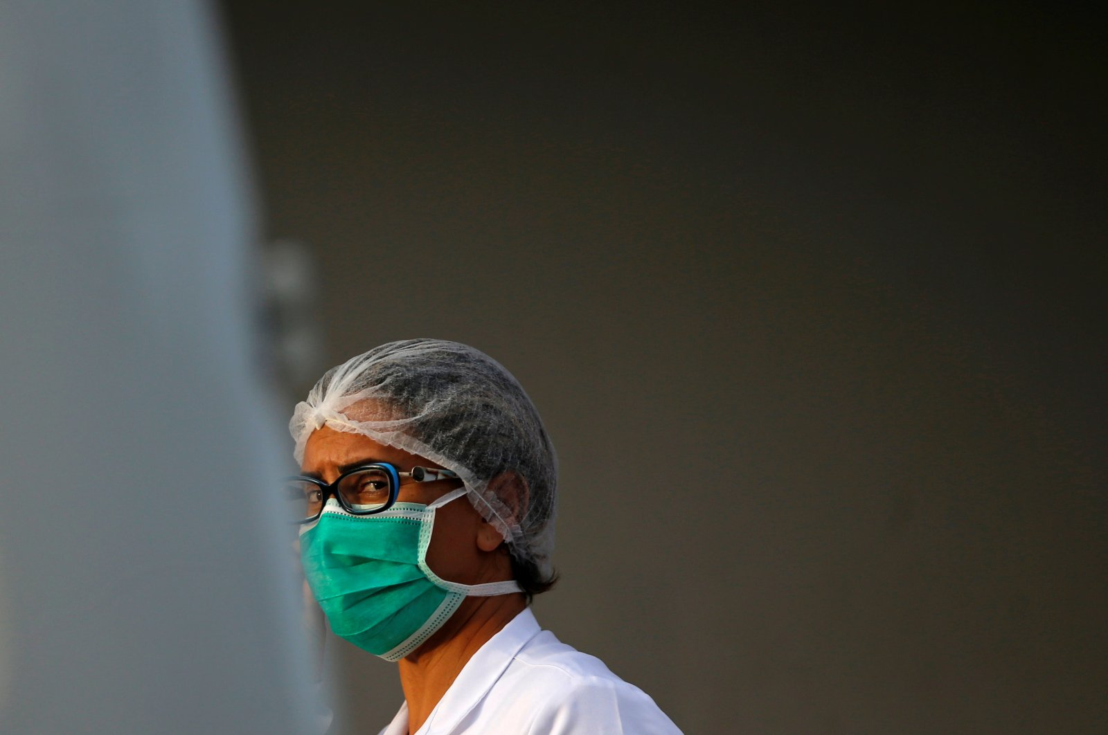 A nurse wears a protective face mask at the North Wing Regional Hospital after reports of the coronavirus in Brasilia. Nurses are usually the first to pay the price of an overloaded health care system. (Reuters Photo)