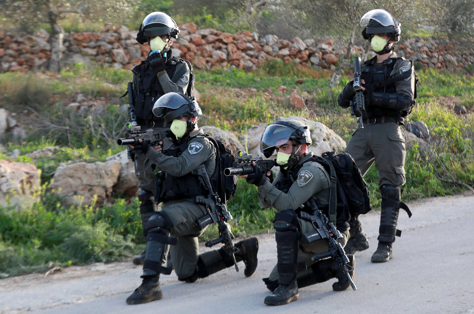 Israeli border police wearing masks aim their weapons during a Palestinian protest against Israeli settlements, near the town of Beita in the Israeli-occupied West Bank, March 11, 2020. (Reuters Photo)