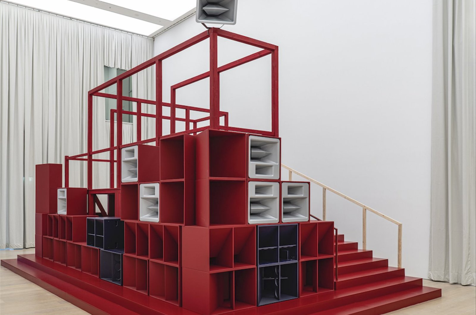"""""""Bergama Stereotip"""" 2019-2020,aArchitectural construction with 13-channel sound, loudspeakers, amplifiers, computer, audio interface, wood, metal molton curtain."""
