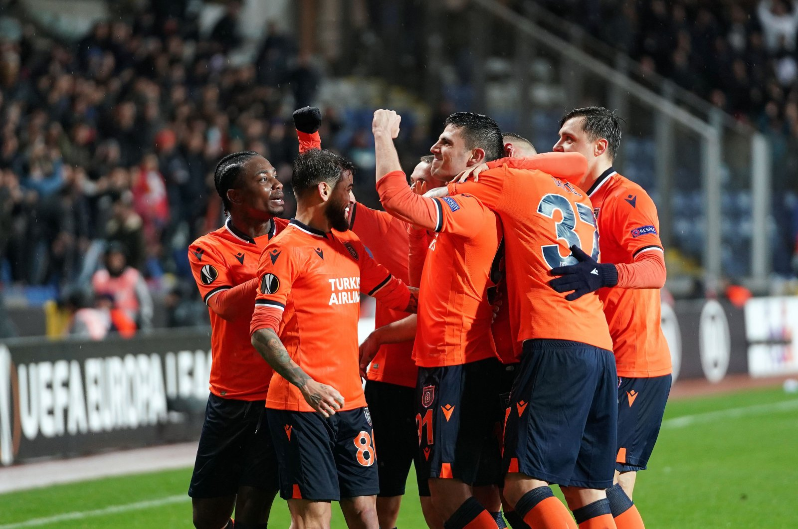 Başakşehir players celebrate advancing to the next round in UEFA Europea League after knocking out Sporting CP, Feb. 27, 2020. (İHA Photo)