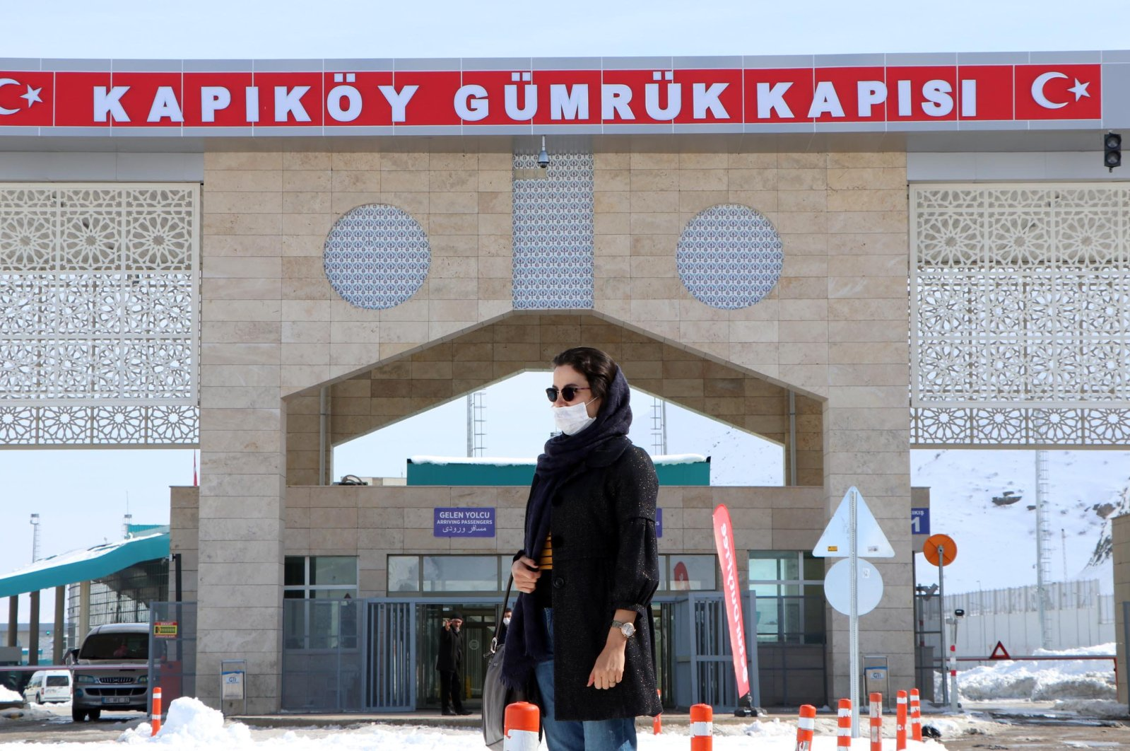 A woman stands in front of the Kapıköy Border Gate in eastern Turkey's Van province near the Iranian border, Feb. 24, 2020. (DHA Photo)