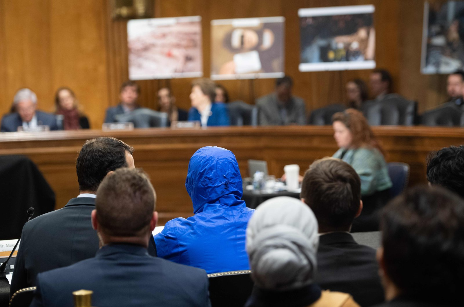 A Syrian military defector using the pseudonym Caesar, while also wearing a hood to protect his identity, testifies about the war in Syria during a Senate Foreign Relations committee hearing on Capitol Hill in Washington, DC, March 11. (AFP Photo)