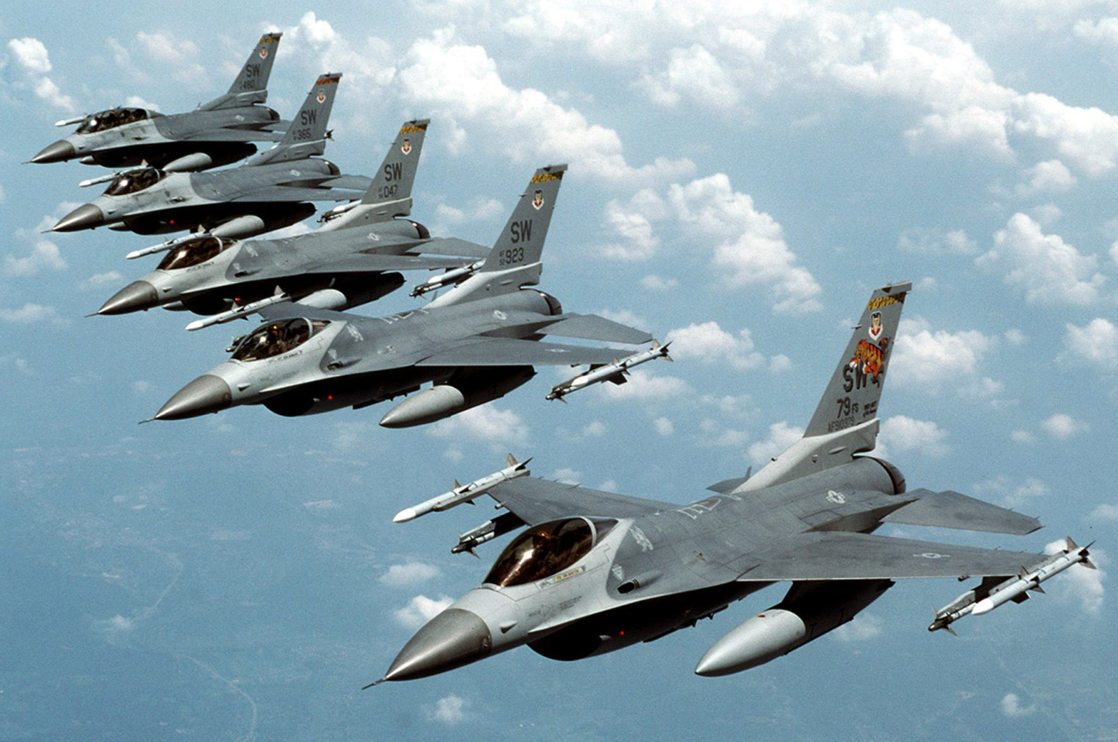 """Five U.S. Air Force F-16 """"Fighting Falcon"""" jets fly in echelon formation over the U.S. en route to an exercise in this undated photograph. (Reuters Photo)"""