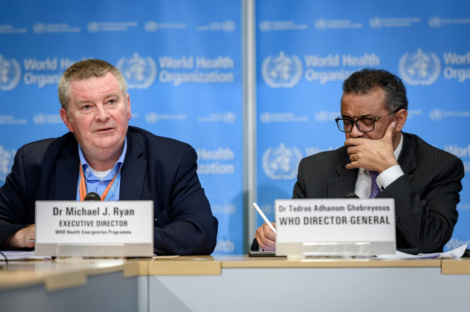 World Health Organization (WHO) Health Emergencies Programme Director Michael Ryan (L) speaks past Director-General Tedros Adhanom Ghebreyesus during a daily press briefing on COVID-19 virus at the WHO headquaters in Geneva on March 9, 2020. (AFP Photo)