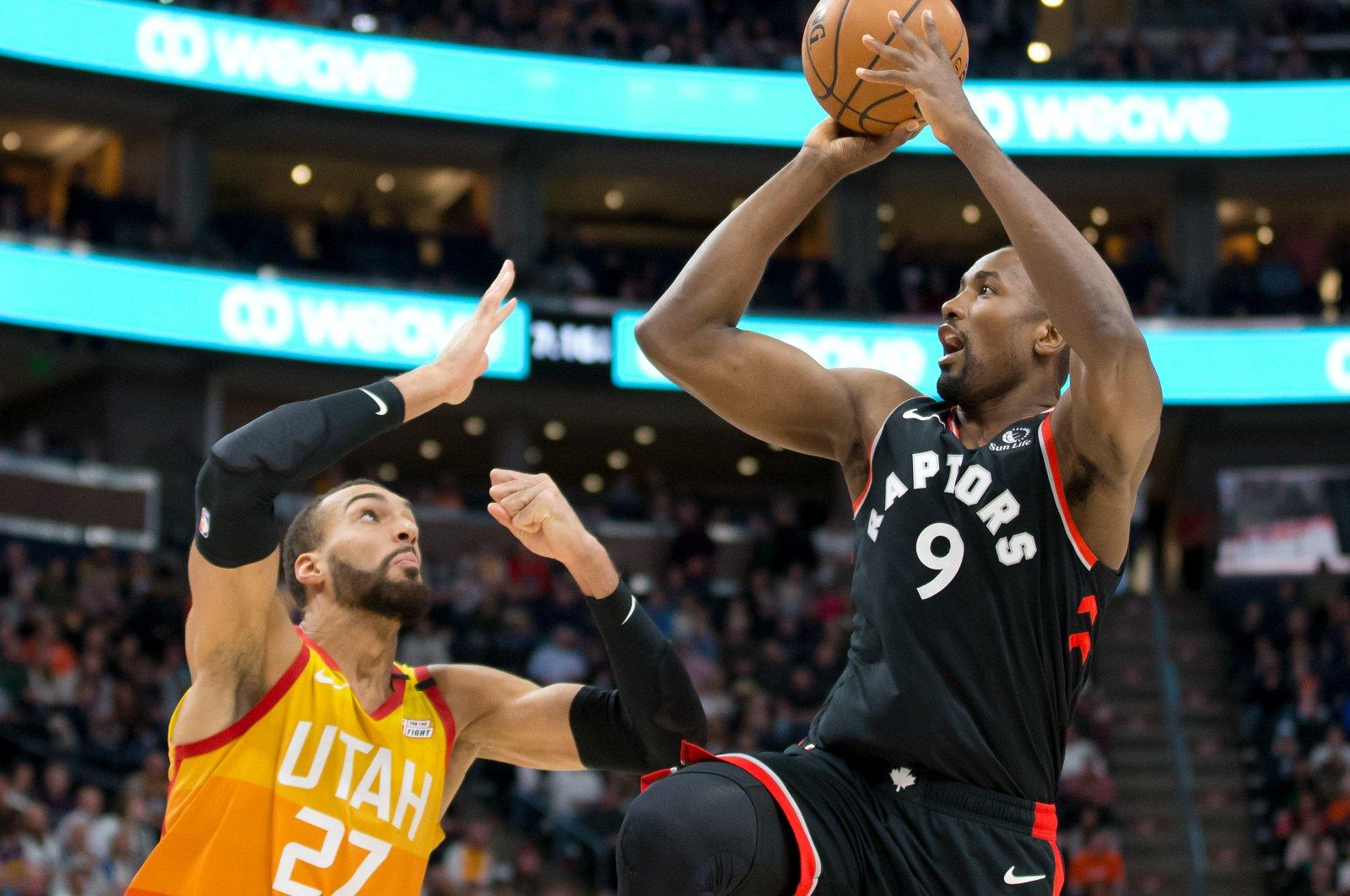 Toronto Raptors center Ibaka shoots the ball against Utah Jazz center Gobert during an NBA match in Salt Lake City, March 9, 2020. (Reuters Photo)