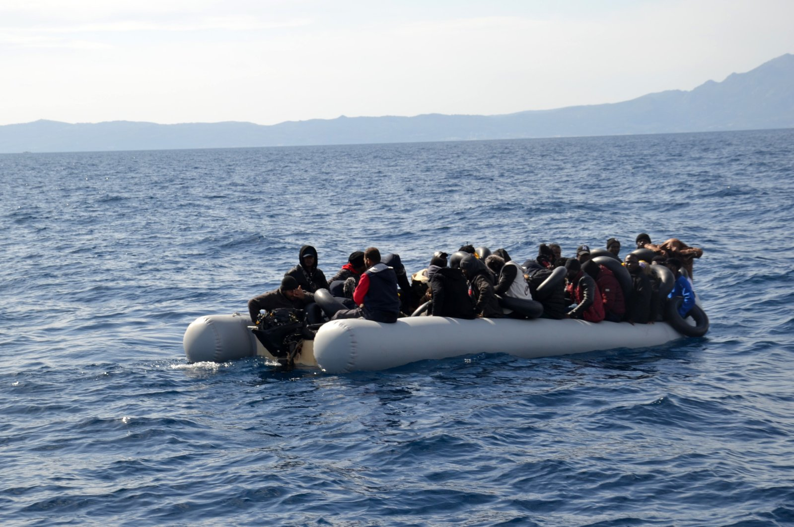 Turkish Coast Guard Command rescues 125 migrants and refugees pushed back into Turkish waters by the Greek coast guard off İzmir province, Thursday, March 12, 2020. (Photo from Coast Guard Command via AA)