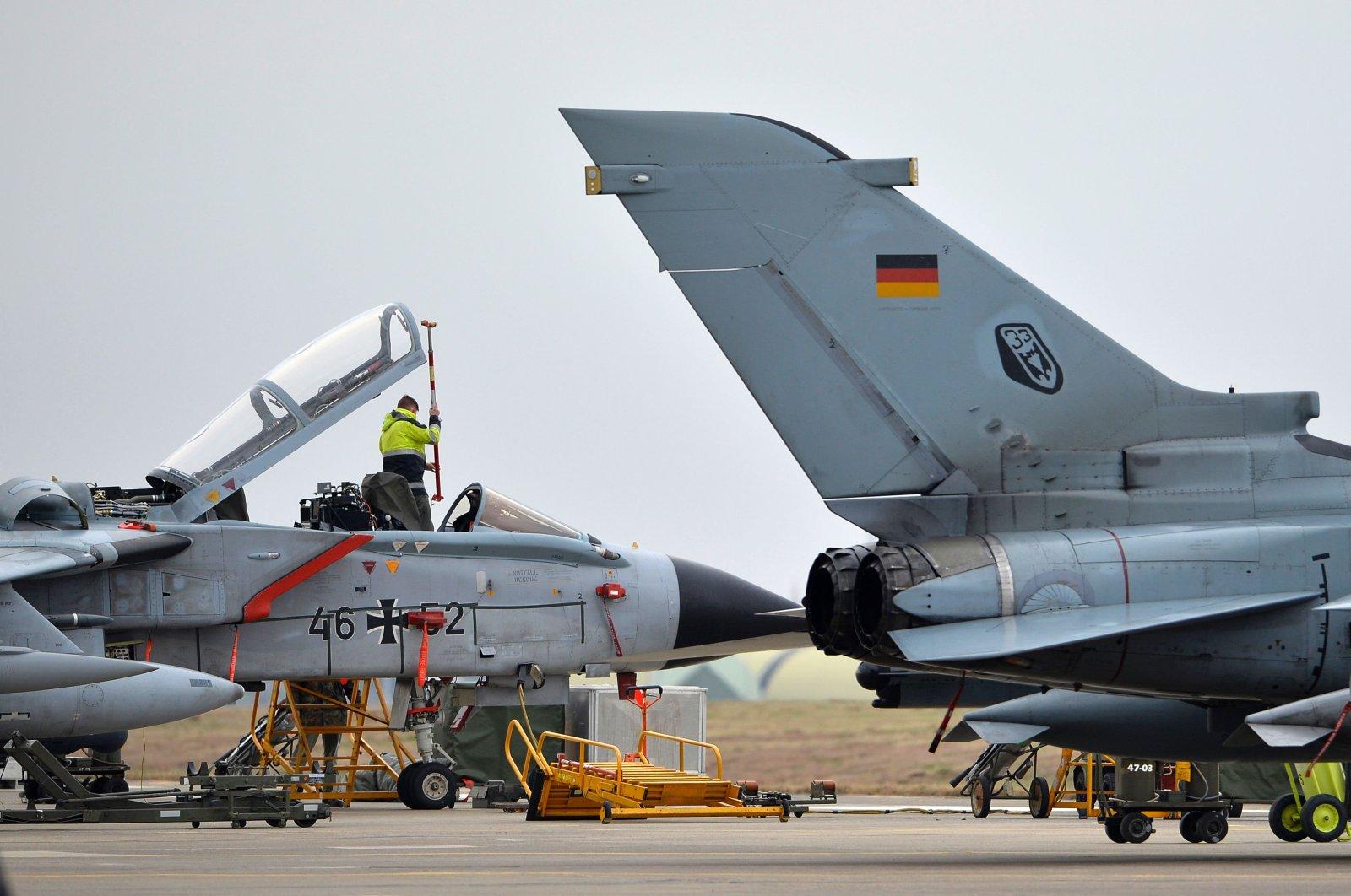 A technician works on a German Tornado jet at an airbase in Incirlik, Turkey, Jan. 21, 2016. (AFP Photo)