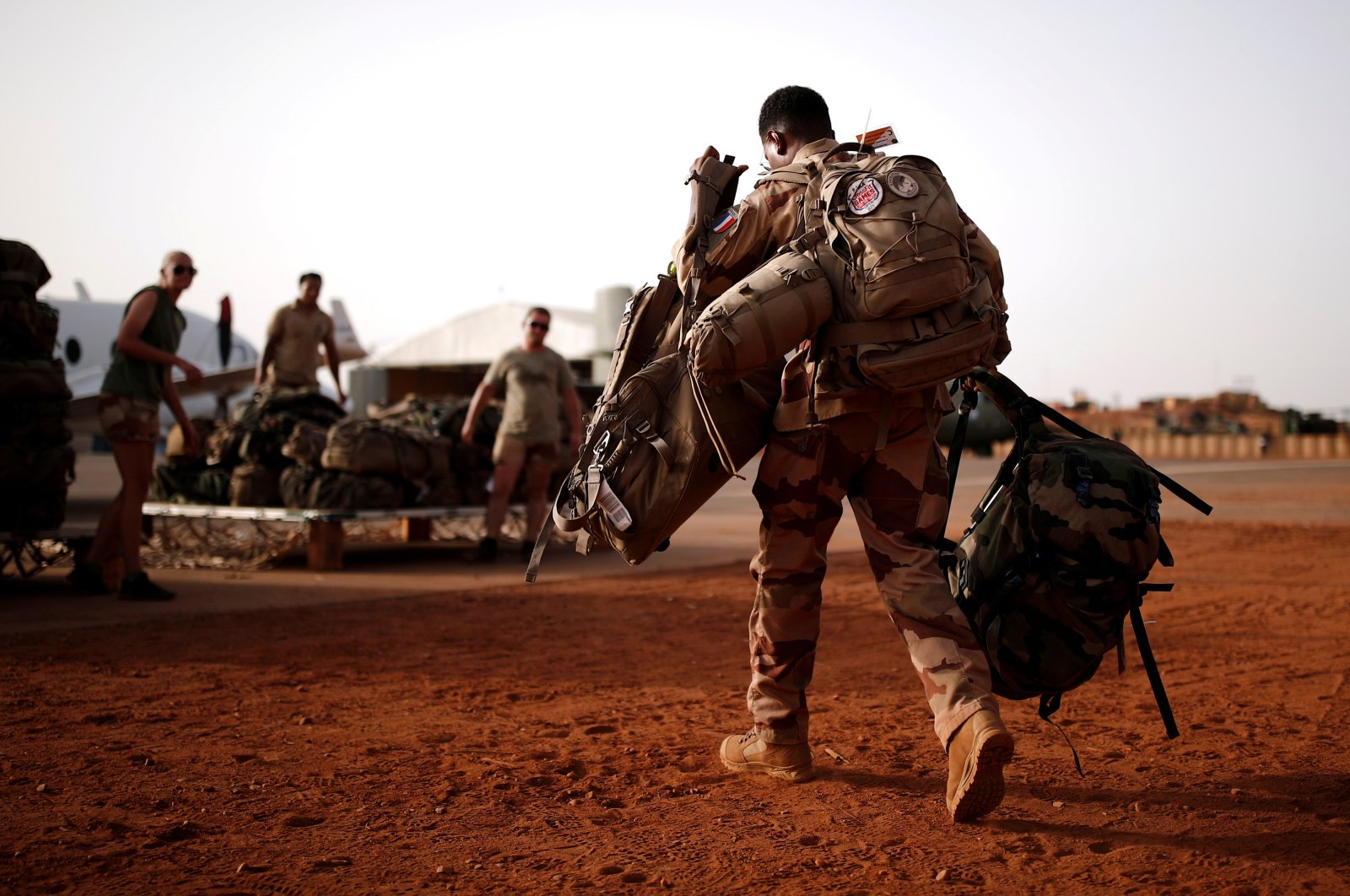 A French soldier leaves with his backpack at the Operational Desert Platform Camp (PfOD) during Operation Barkhane, Gao, Aug. 1, 2019. (Reuters Photo)