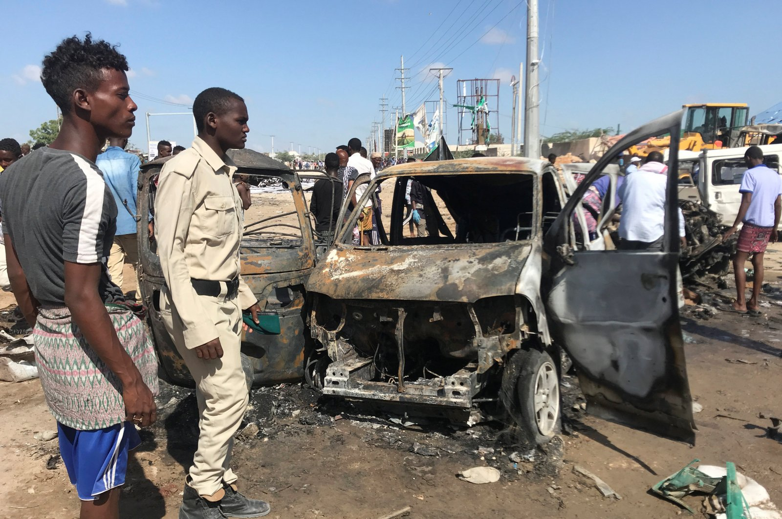 Somali security forces assess the scene of a car bomb explosion at a checkpoint, Mogadishu, Dec. 28, 2019. (REUTERS Photo)