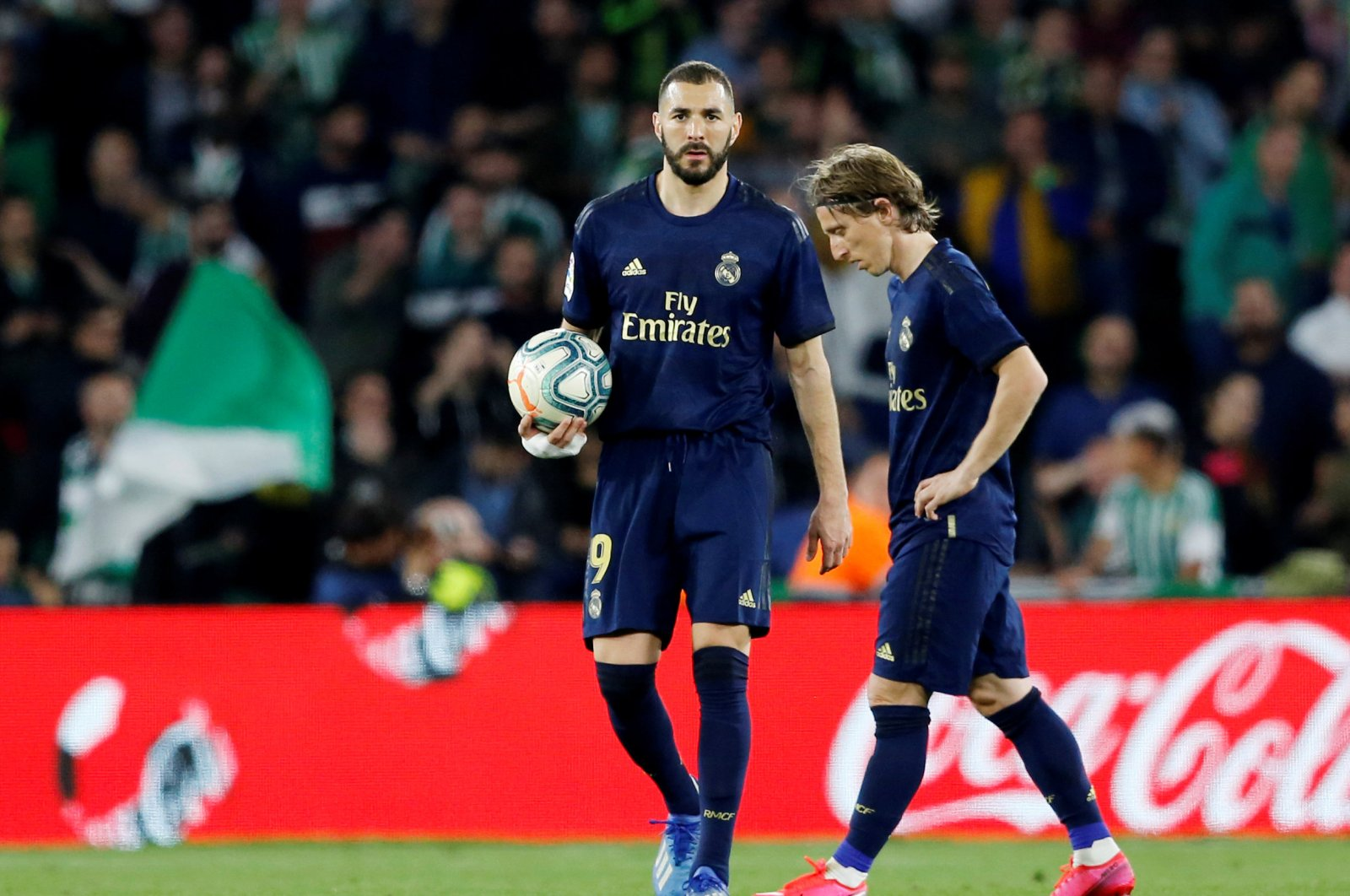 Real Madrid's Karim Benzema and Luka Modric react after Real Betis' first goal during a La Liga match, March 8, 2020. (Reuters Photo)