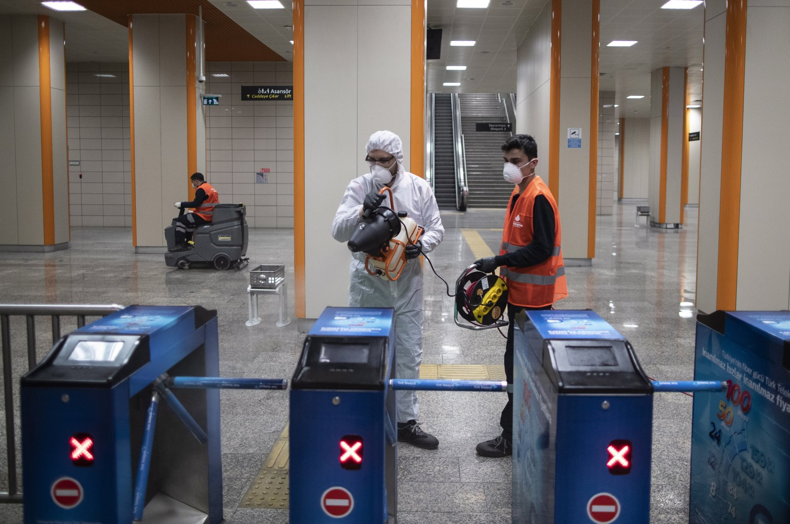 Employees of the Istanbul Metropolitan Municipality disinfects a metro station to prevent the spread of the novel coronavirus, COVID-19, in Istanbul, Wednesday, March 11, 2020. (EPA Photo)