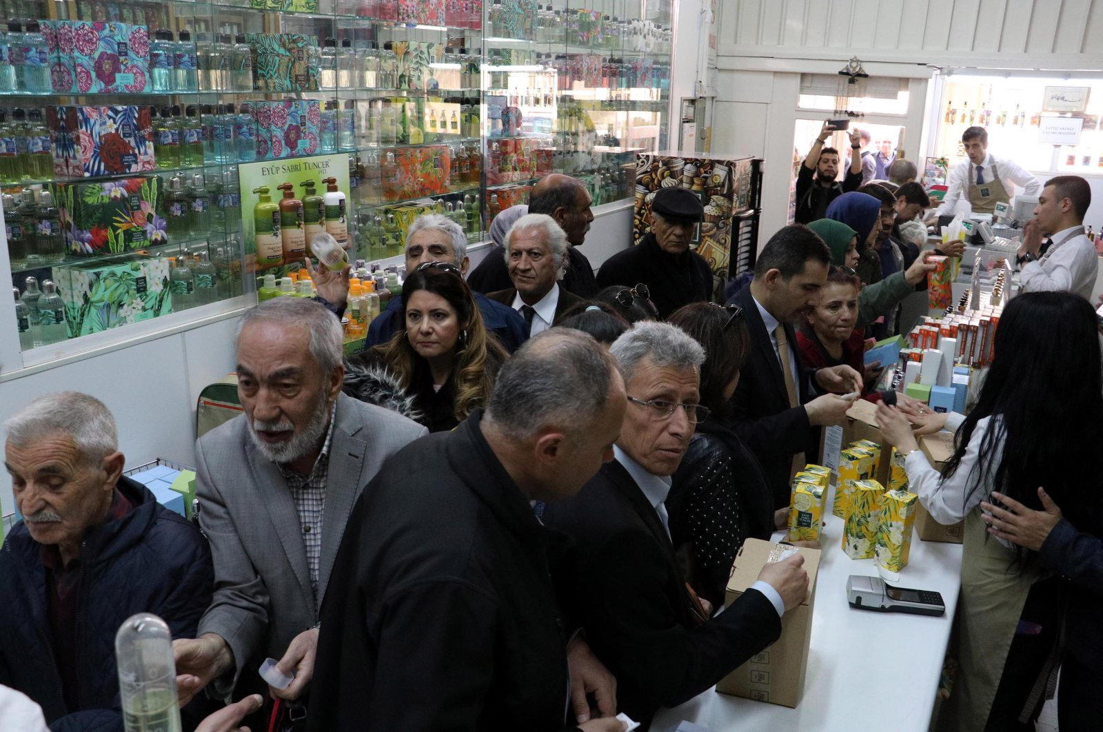 A crowd of customers waits to make purchases at a cologne shop in Ankara, Thursday, Mar. 12, 2020. (DHA Photo)