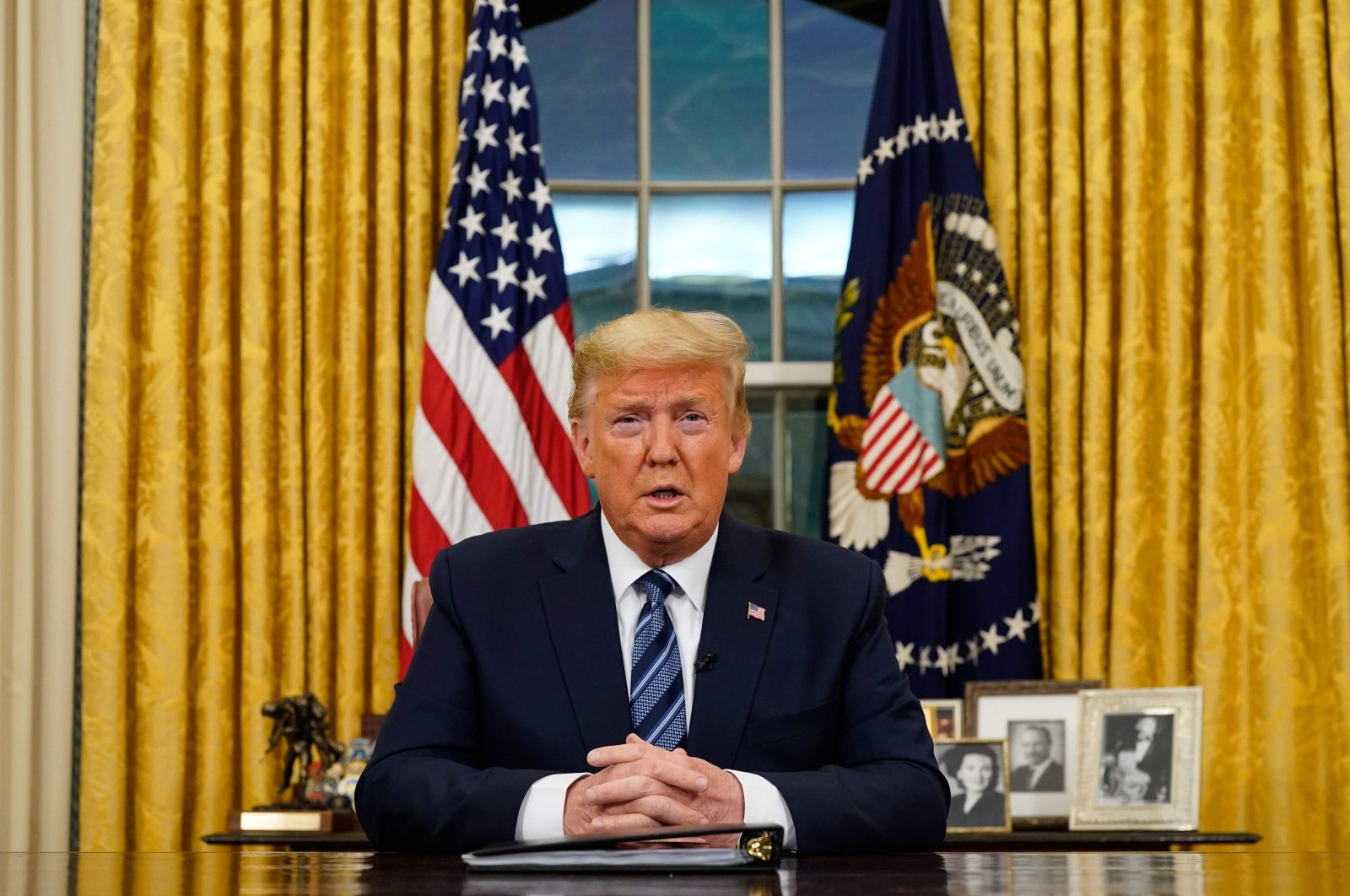 U.S. President Donald Trump addresses the nation from the Oval Office, Washington, D.C., March 11, 2020. (AFP Photo)