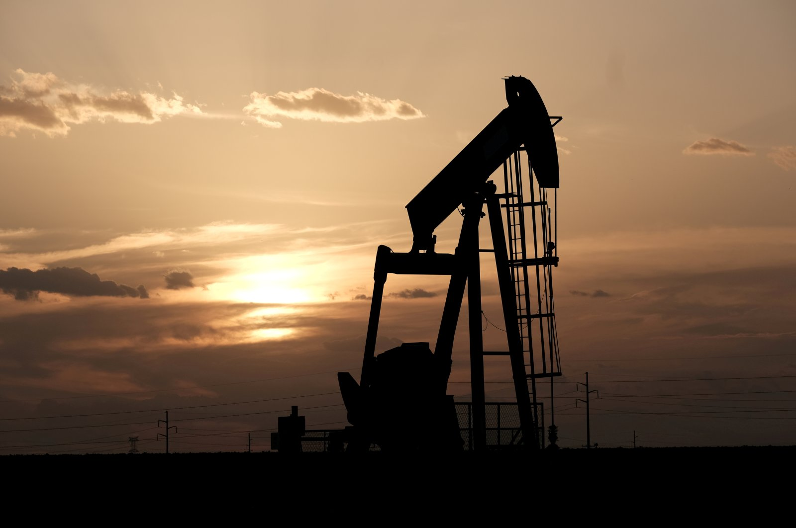 Oil pump jacks work at sunset near Midland, Texas, U.S., Aug. 21, 2019. (Reuters Photo)