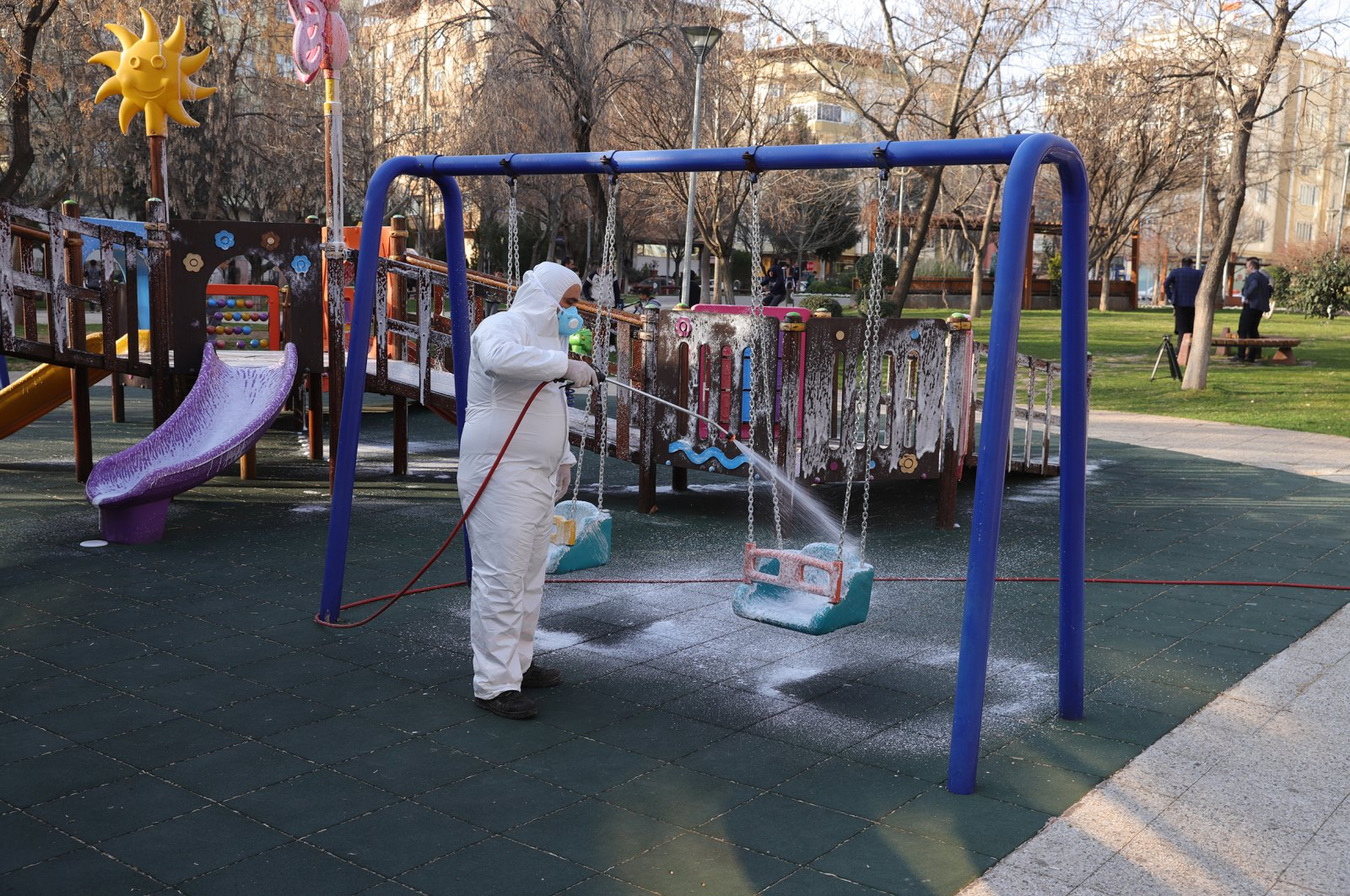 A worker disinfects a playground in Gaziantep, Thursday, March 12, 2020. (AA Photo)