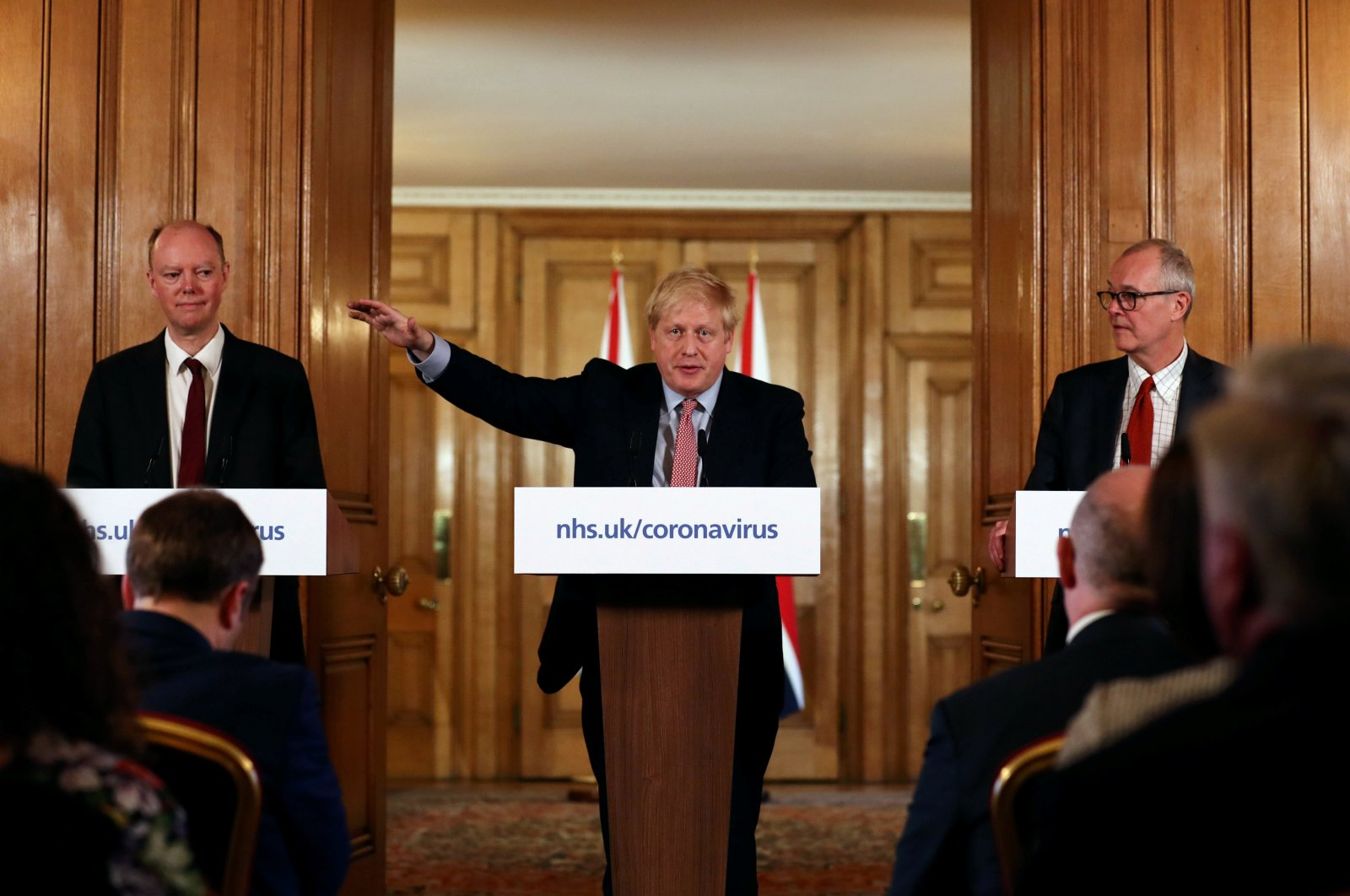 British Prime Minister Boris Johnson, Chief Medical Officer for England, Chris Whitty and Government Chief Scientific Adviser, Sir Patrick Vallance attend a news conference addressing the government's response to the coronavirus outbreak, at Downing Street in London, Britain March 12, 2020. (Reuters Photo)