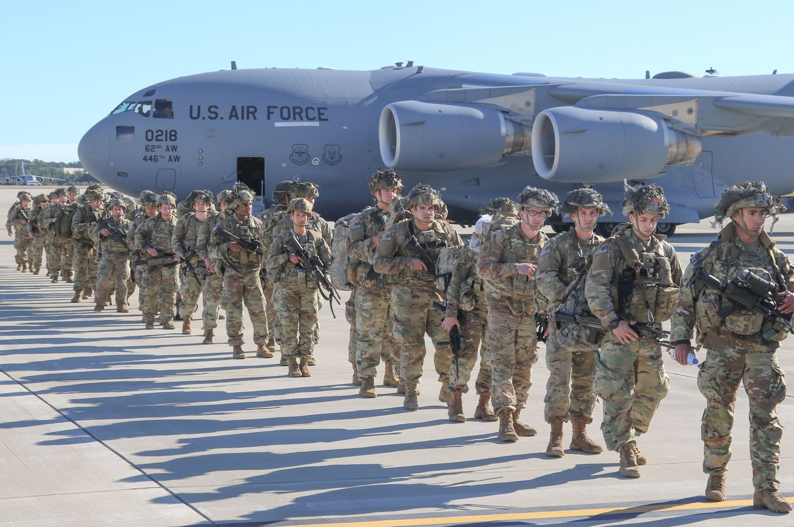 This handout picture released by the US Army shows U.S. Army Paratroopers assigned to the 2nd Battalion, 504th Parachute Infantry Regiment, 1st Brigade Combat Team, 82nd Airborne Division, deploy from Pope Army Airfield, North Carolina on January 1, 2020. (AFP Photo)