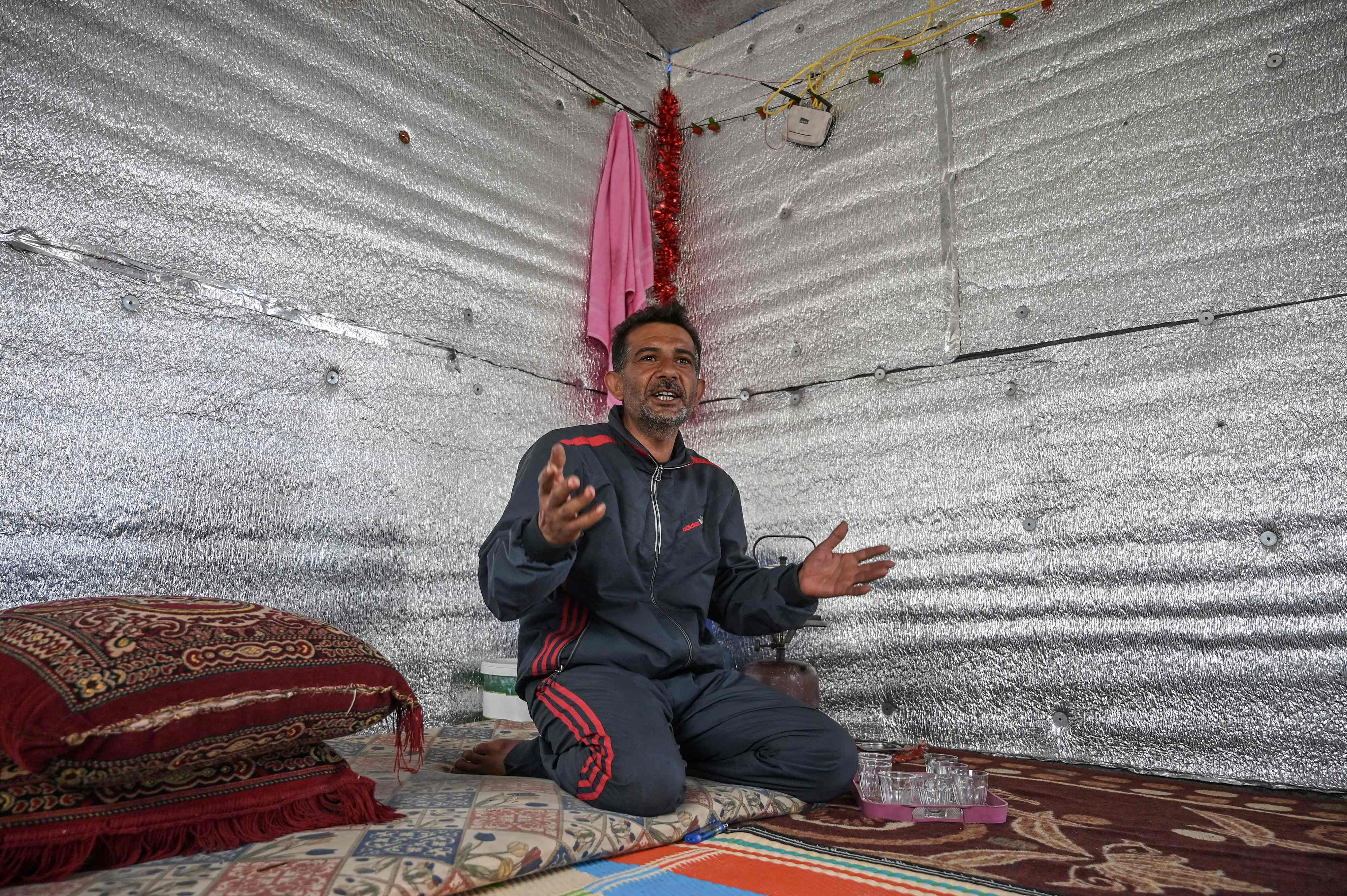 Hamad al-Abdallah,in his new concrete home at a camp created by Turkey's Humanitarian Relief Foundation (IHH) near Kafr Lusin on the border with Turkey in Syria's northwestern province of Idlib, March 10, 2020. (AFP)