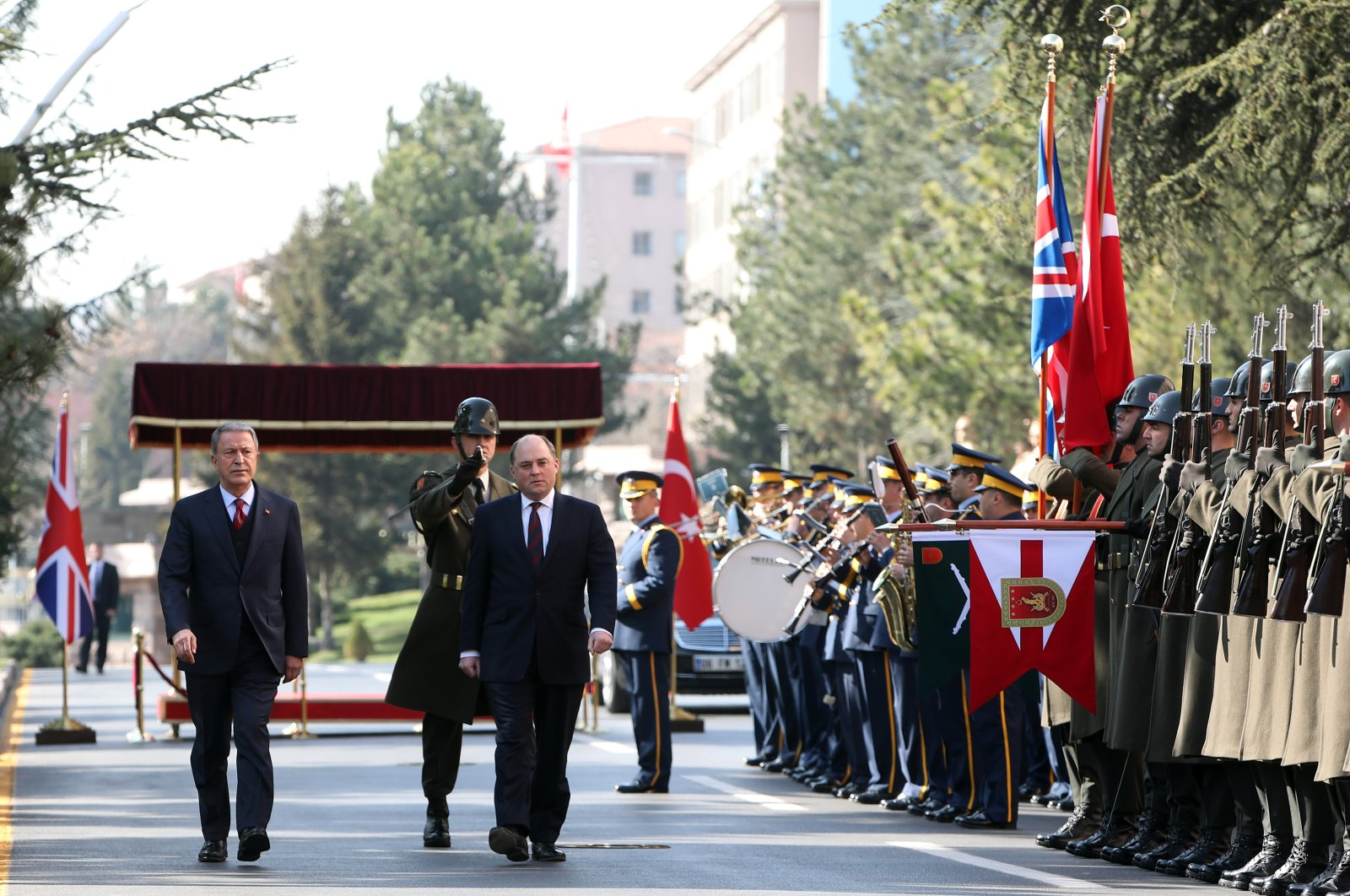 Defense Minister Hulusi Akar and his British counterpart Ben Wallace attend a military ceremony to welcome the delegation in Ankara, Thursday, March 12, 2020. (AA Photo)