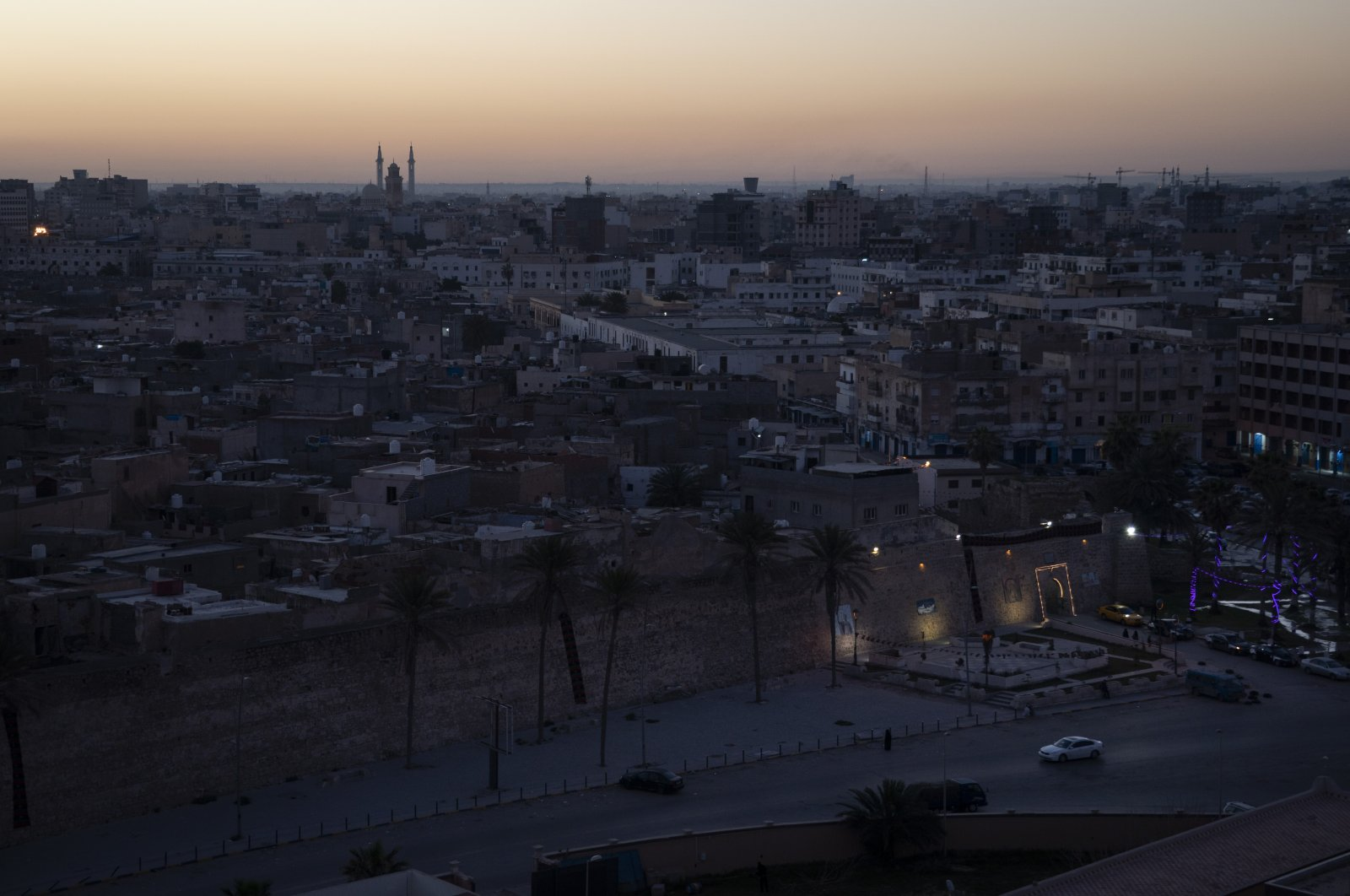 In this Feb. 29, 2020 photo, the walls surrounding the Old City are illuminated before sunrise in Tripoli, Libya. The country plunged into chaos in 2011, when a civil war toppled longtime dictator Moammar Gadhafi, who was later killed. (AP Photo)