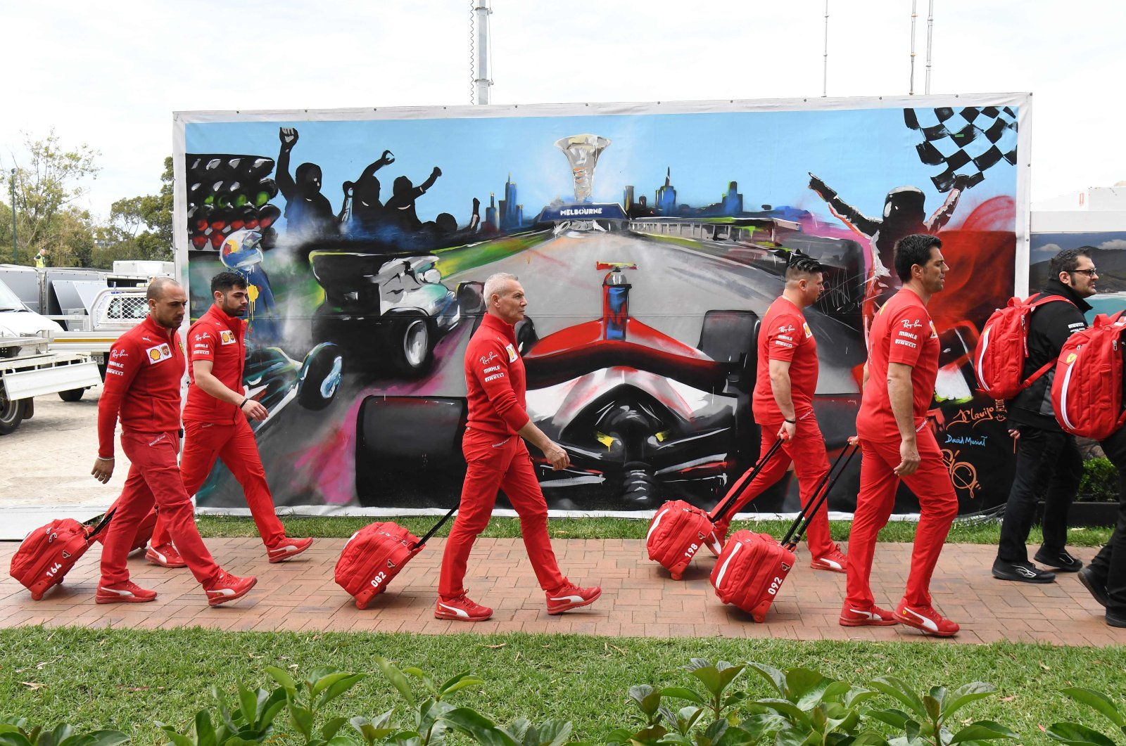 Members of the Ferrari team arrive to pack up their equipment after the Australian Grand Prix was canceled, Melbourne, March 13, 2020. (AFP Photo)