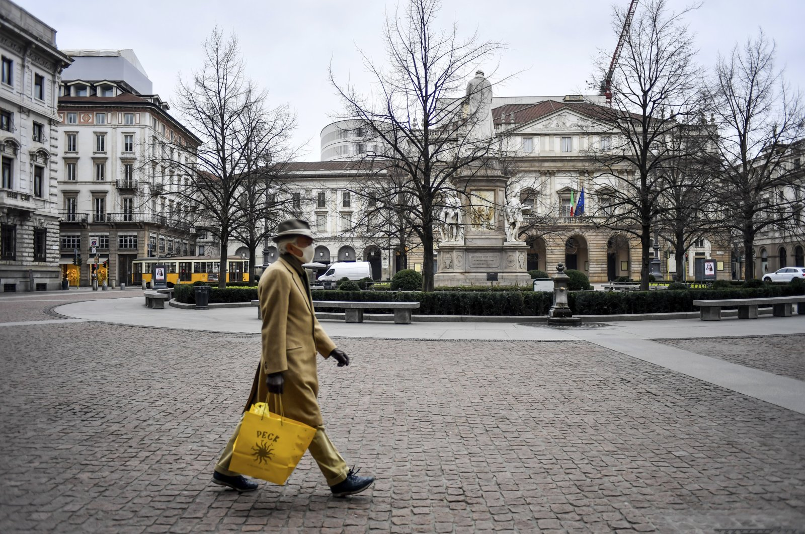 A man walks in Piazza della Scala square in Milan, Italy, Thursday, March 12, 2020. (AP Photo)