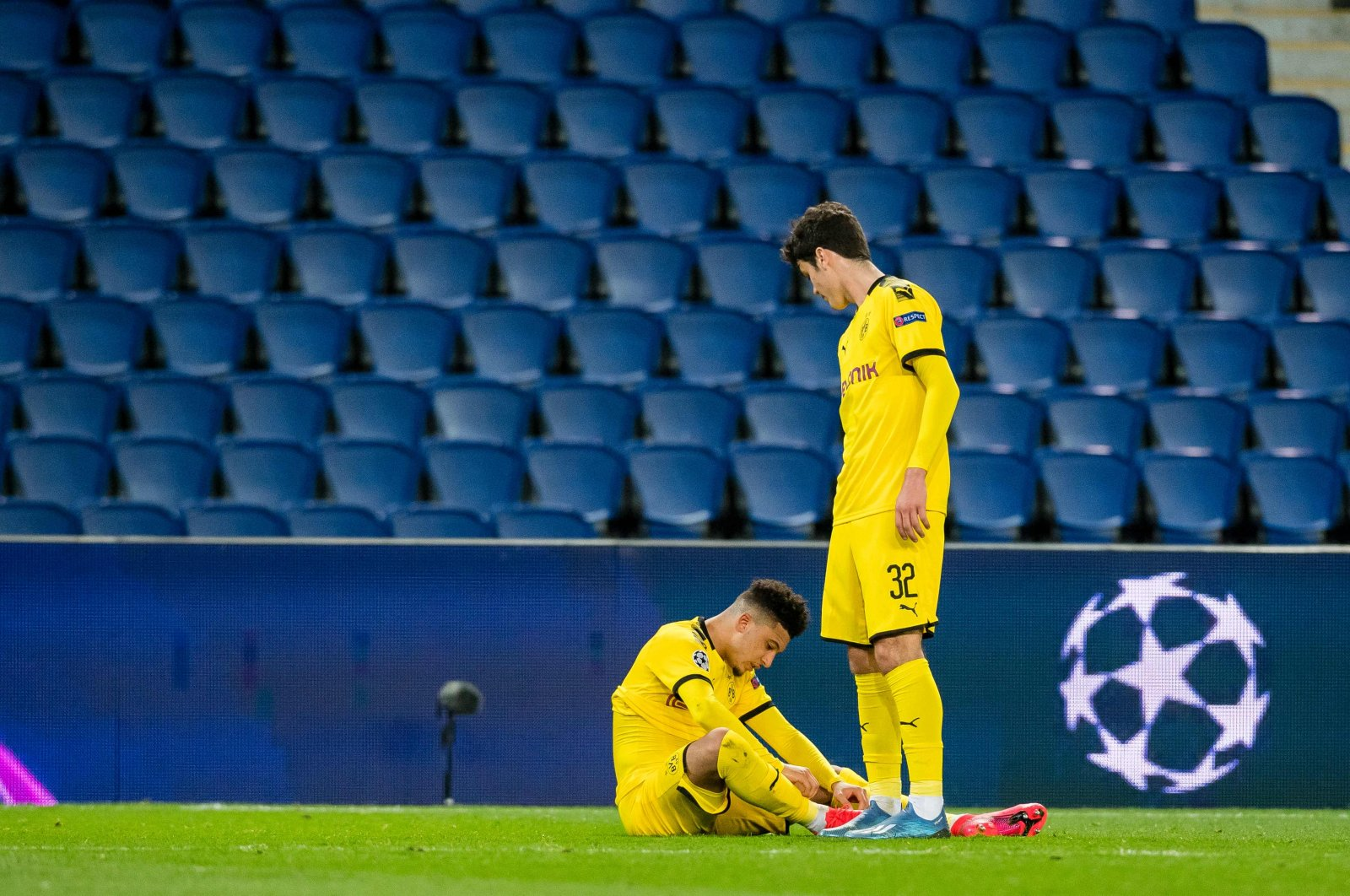 Dortmund's midfielders Jadon Sancho (L) and Giovanni Reyna react after losing the Champions League match against Paris Saint-Germain, Paris, March 11, 2020. (AFP Photo)