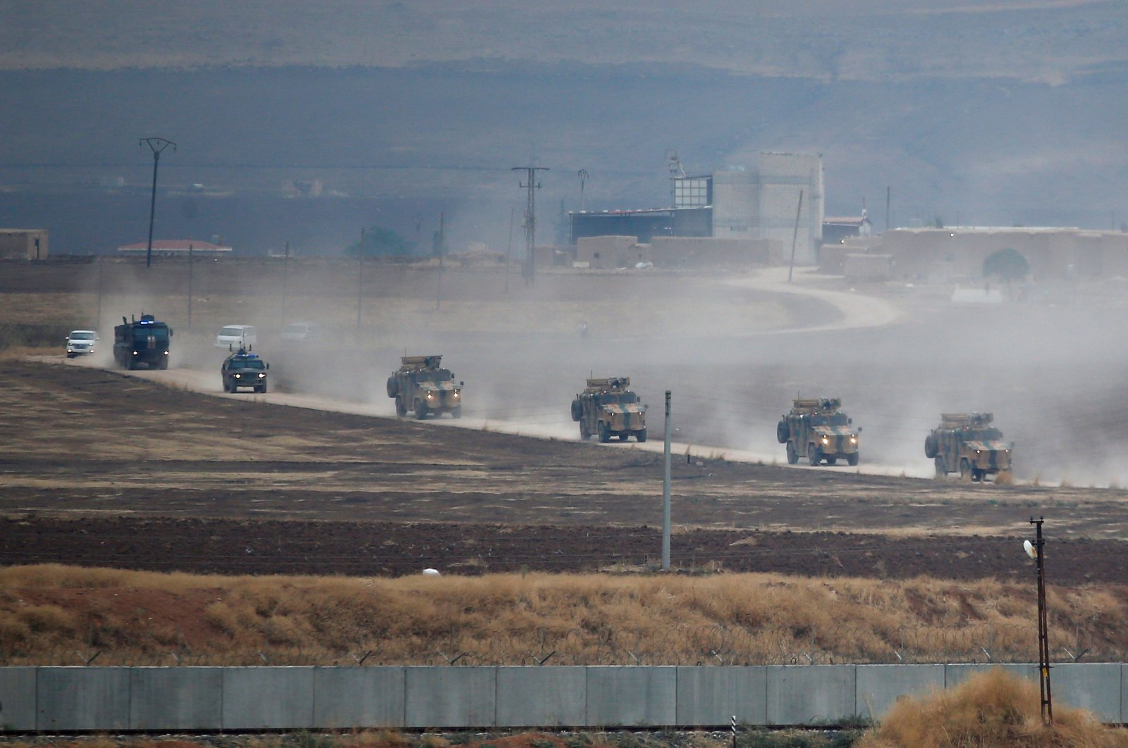 Turkish and Russian military vehicles near the Turkish border town of Kızıltepe in Mardin province return following a joint patrol in northeast Syria, Nov. 1, 2019. (Reuters Photo)