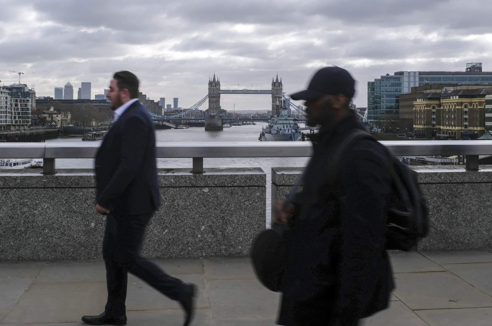 People commute across London Bridge, London, March 13, 2020. (AP Photo)