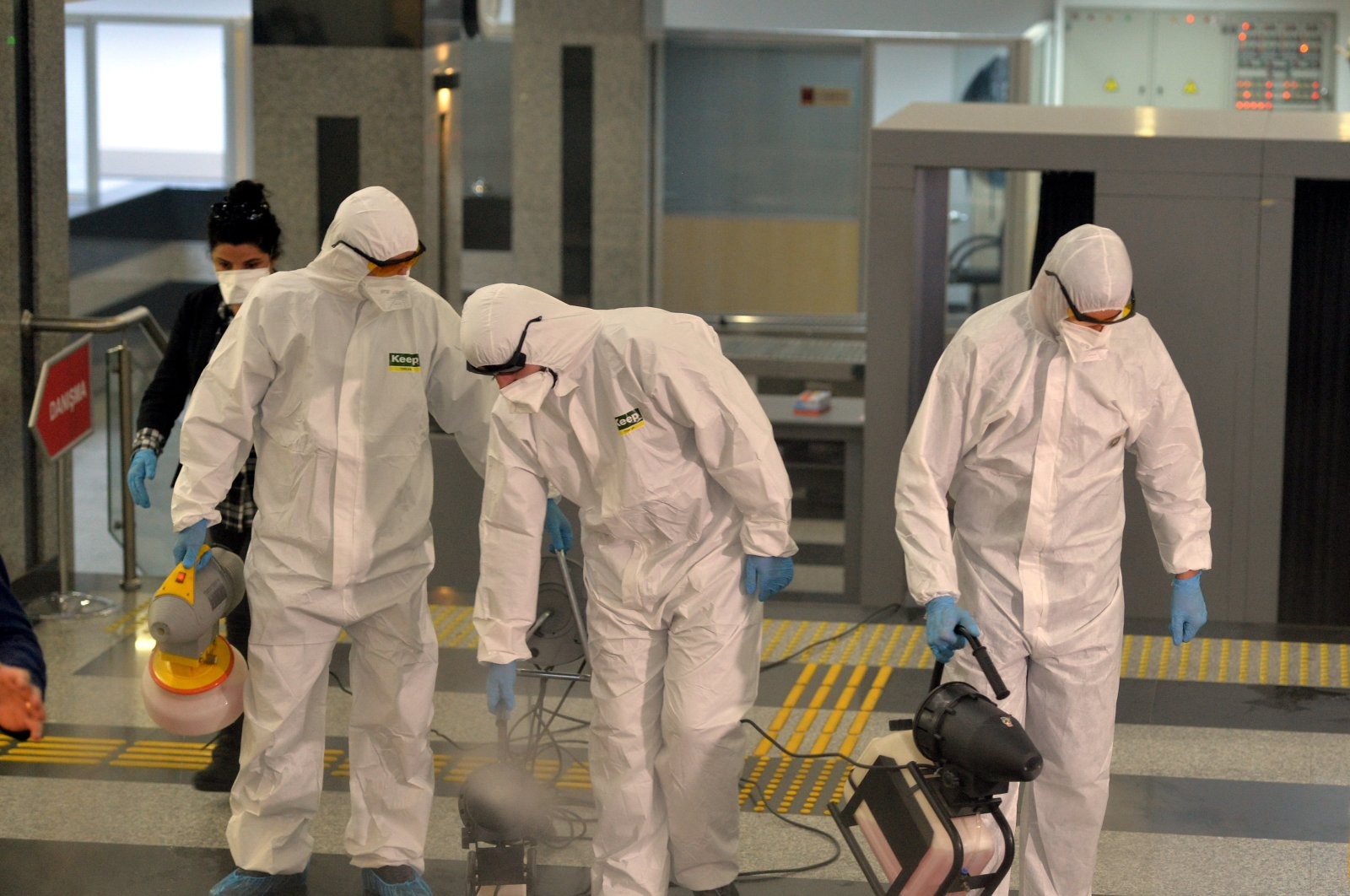 A group of employees in protective uniforms disinfects the Turkish Parliament, Mar. 13, 2020. (AA Photo)