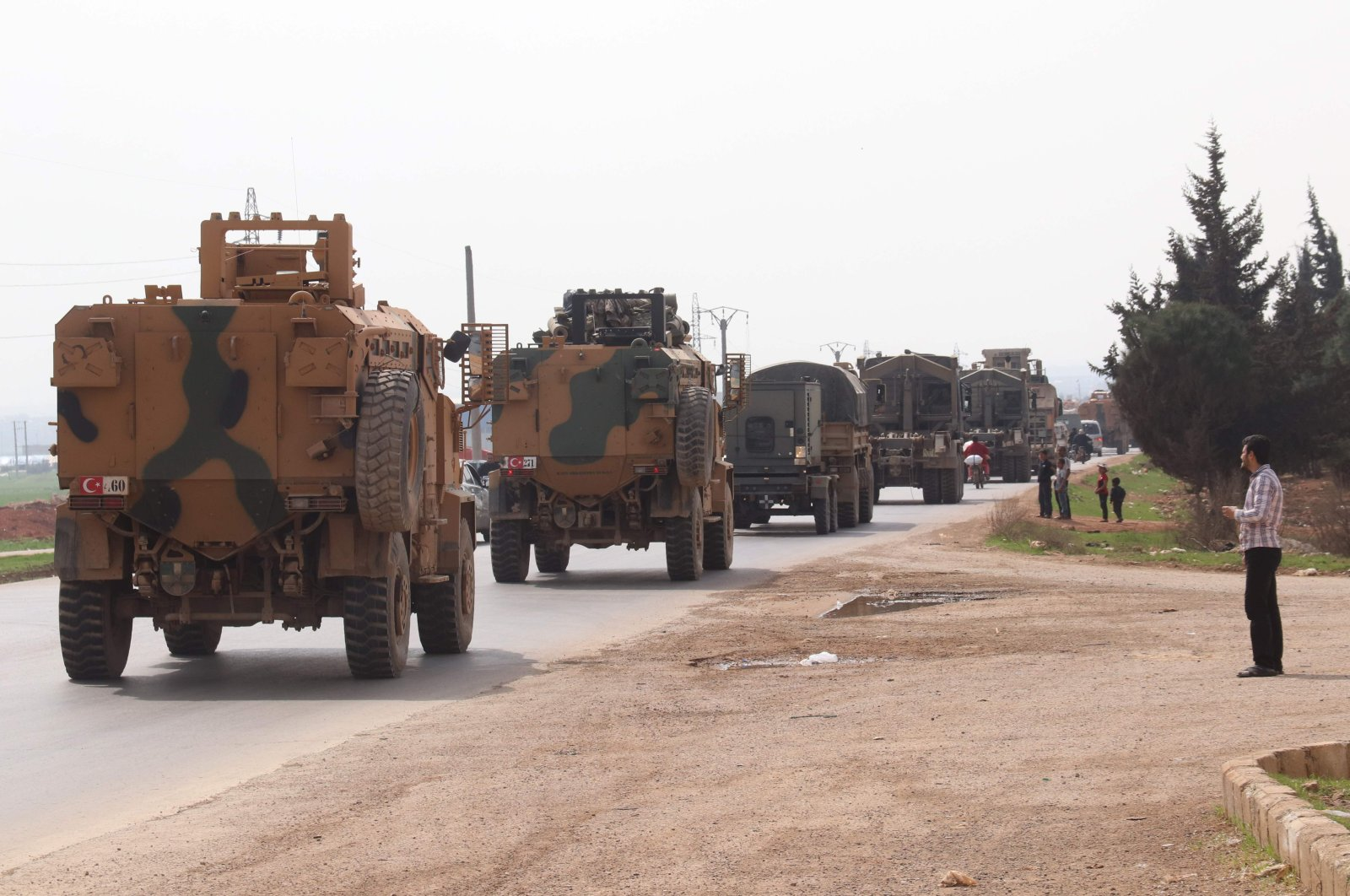 A Turkish military convoy drives near the Syrian town of Kefraya on the highway linking the northwestern Syrian province of Idlib to the Bab al-Hawa border crossing, March 10, 2020. (AFP Photo)