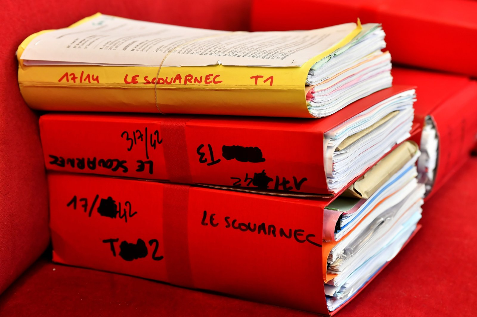 Files are displayed in the courtroom during the opening day of a French surgeon's trial for the rape and sexual abuse of four children, Saintes, March 13, 2020. (AFP Photo)