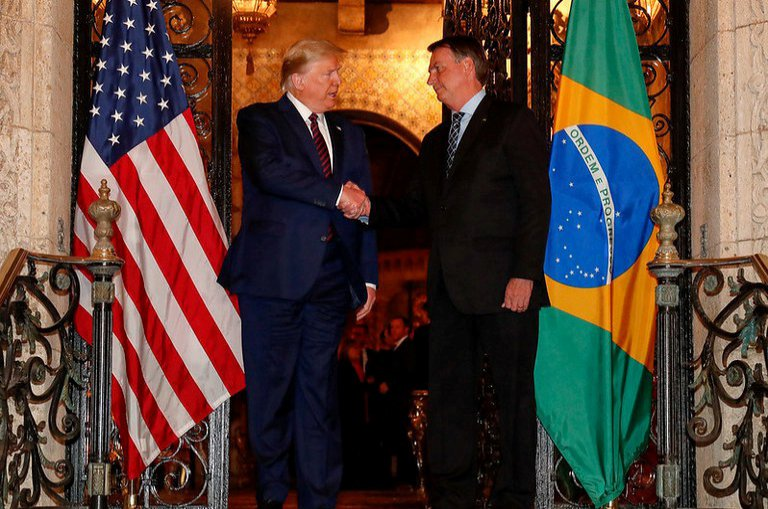 U.S. President Donald Trump shakes hands with Brazil's President Jair Bolsonaro at his Mar-a-Lago residency in Palm Beach, Florida, U.S., March 7, 2020, in this picture obtained from social media. (Reuters Photo)