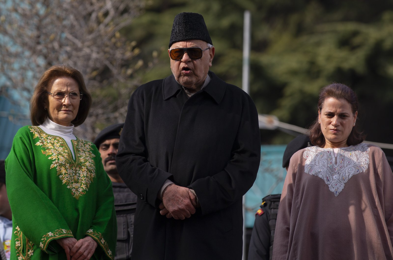 Former Chief Minister of Jammu and Kashmir and National Conference party president Farooq Abdullah,(C) flanked by his wife Molly Abdullah, (L) and daughter Safia Abdullah speaks to media persons at his residence, Srinagar, March 13, 2020. (AP Photo)