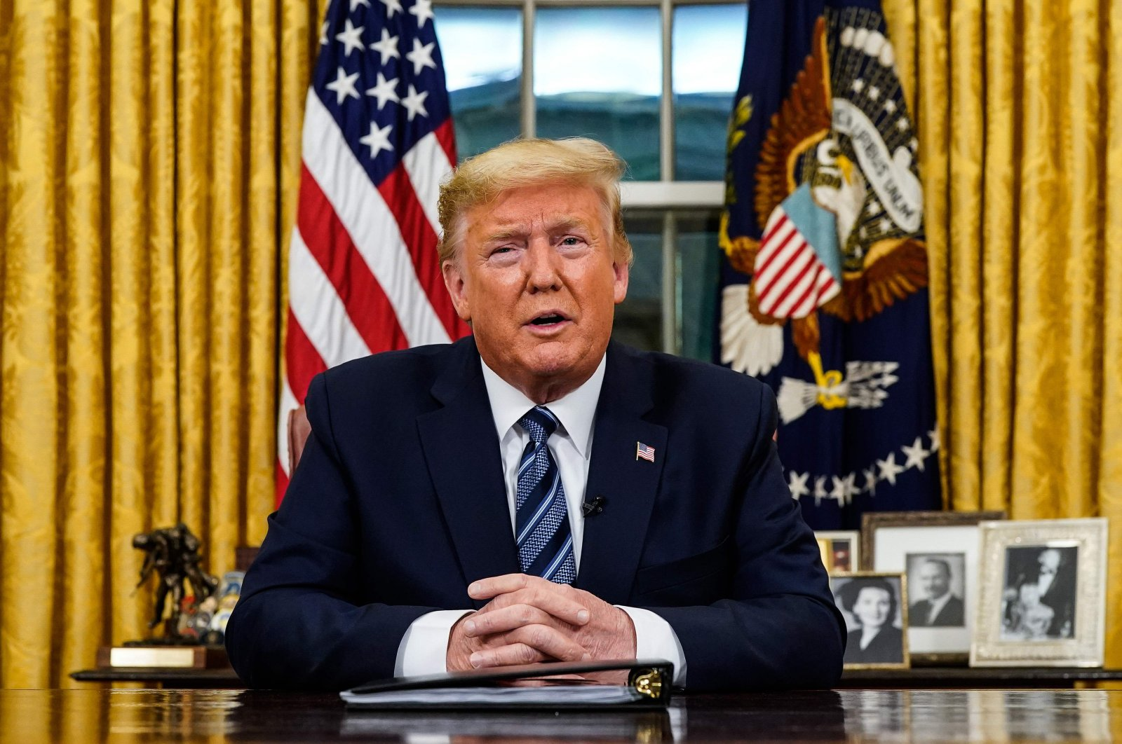 U.S. President Donald Trump addresses the nation from the Oval Office about the widening novel coronavirus crisis, in Washington, D.C. on March 11, 2020. (AFP Photo)